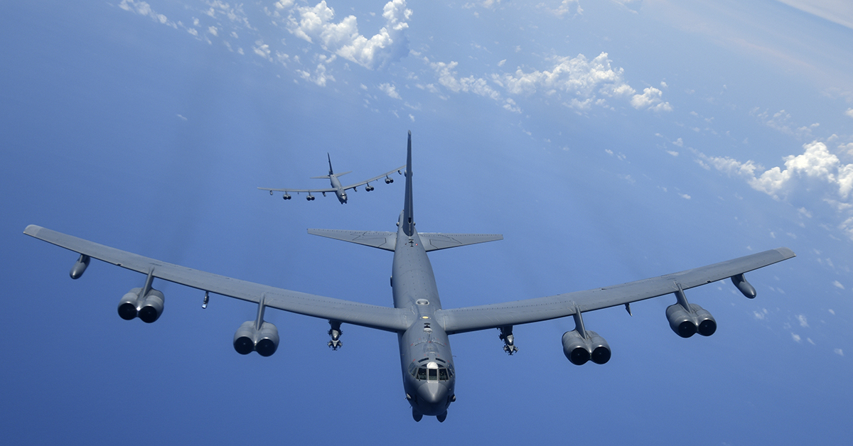 Two B-52H Stratofortress bombers fly over the Pacific Ocean during a routine training mission Aug. 2, 2018. This mission was flown in support of U.S. Indo-Pacific CommandÕs Continuous Bomber Presence operations, which are a key component to improving combined and joint service interoperability. (A1C Gerald R. Willis/Air Force)