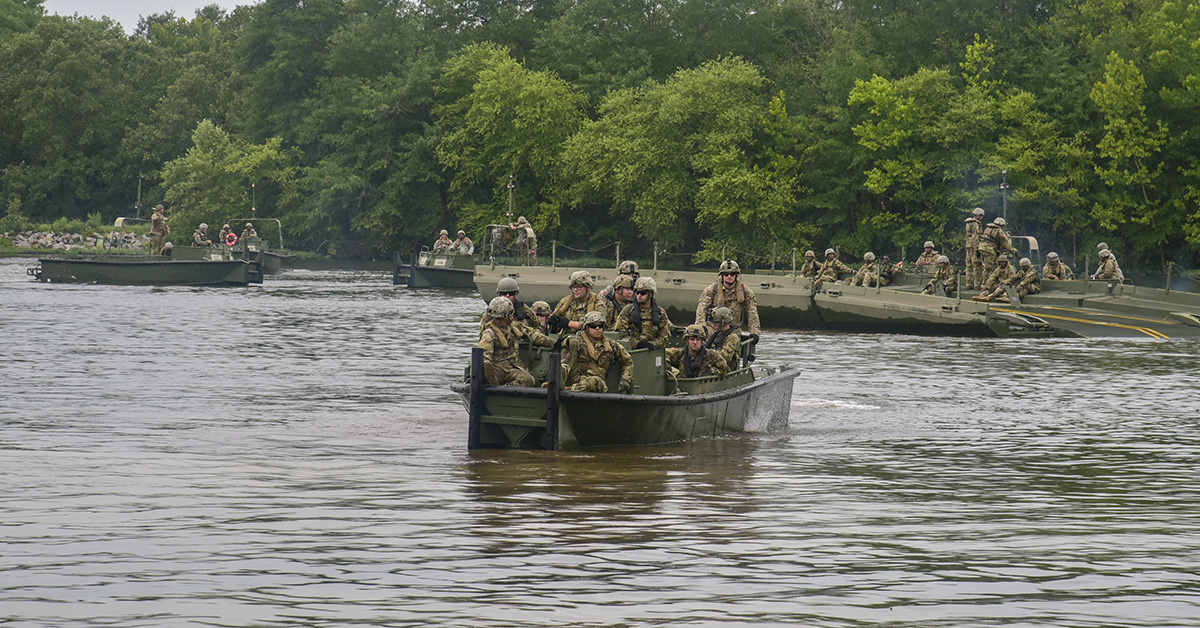 Soldiers with the 489th Engineer Battalion, part of the 420th Engineer Brigade, conduct wet gap crossing training during River Assault 2018 at Fort Chaffee, Arkansas, July 18, 2018. (First Sgt. Daniel Griego/Army Reserve)