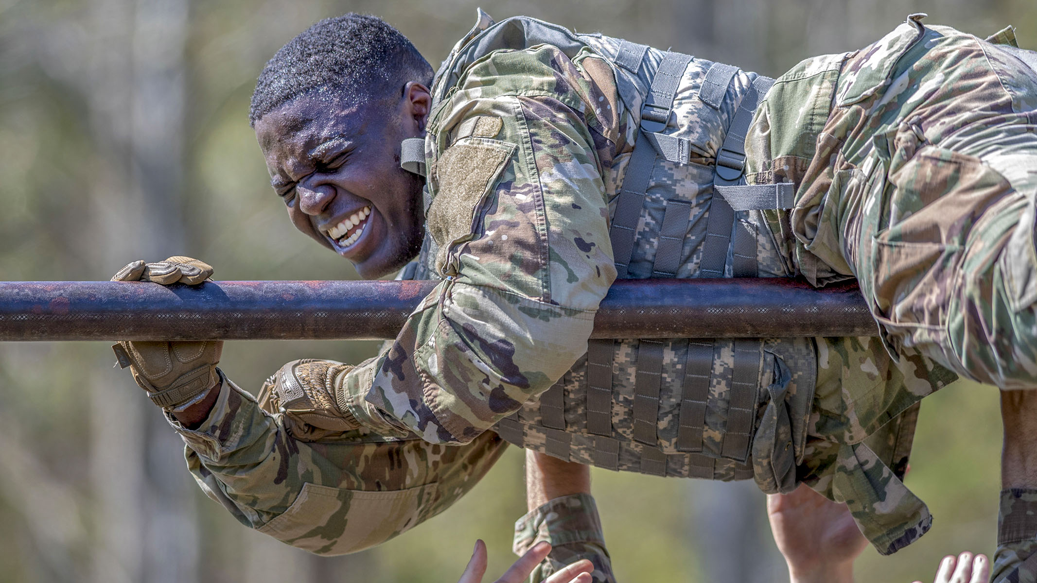 U.S. Army Tradale Bryant, assigned to 55th Signal Company (Combat Camera), pulls himself over a high bar during the obstacle course portion of the 2018 SPC Hilda I. Clayton Best Combat Camera Competition, Marine Corps Base Quantico, Virginia, May 1, 2018. The competition is an annual event open to all branches of the military, it's hosted by the 55th Signal Company (Combat Camera) in order to test the technical and tactical proficiencies of Department of Defense combat photographers. (Staff Sgt. Pablo N. Piedra/Army)