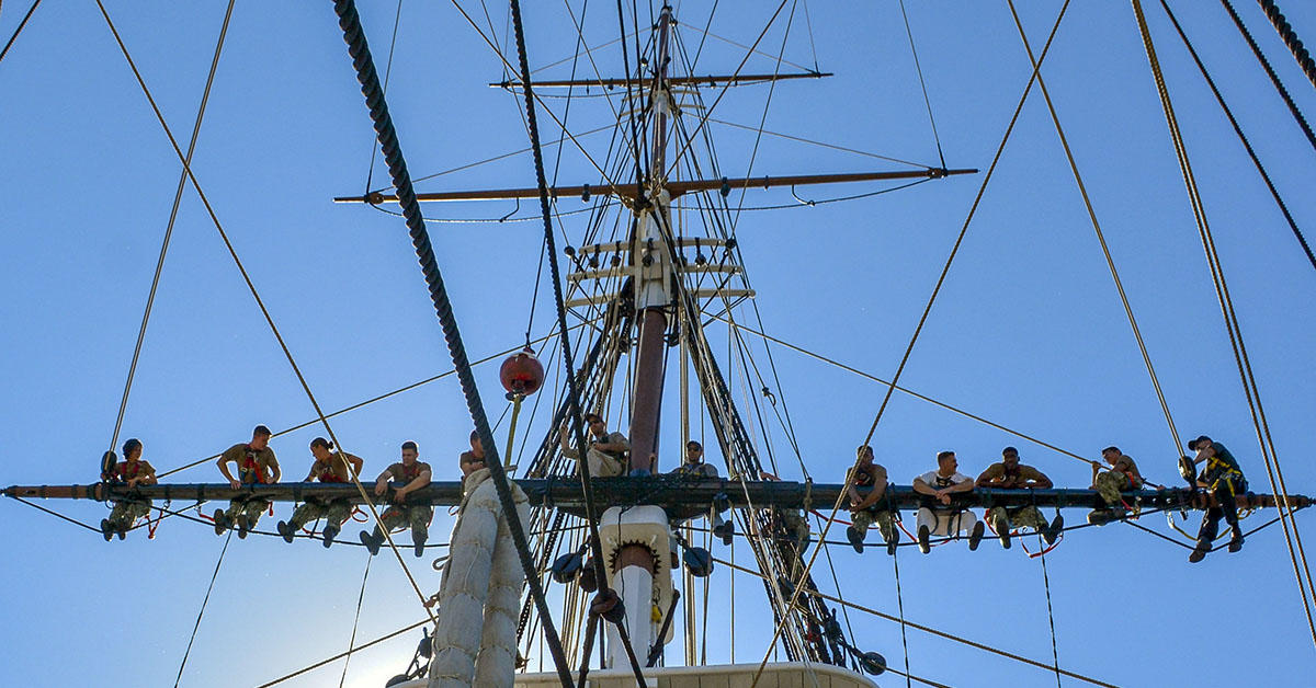 Sailors assigned to USS Constitution get into position on ÔOld IronsidesÕ mizzen topsail yard before bending on the mizzen topsail during weekly sail training. ConstitutionÕs crewmembers conduct weekly training to learn and retain sailing information. (MC3 Casey Scoular/Navy)