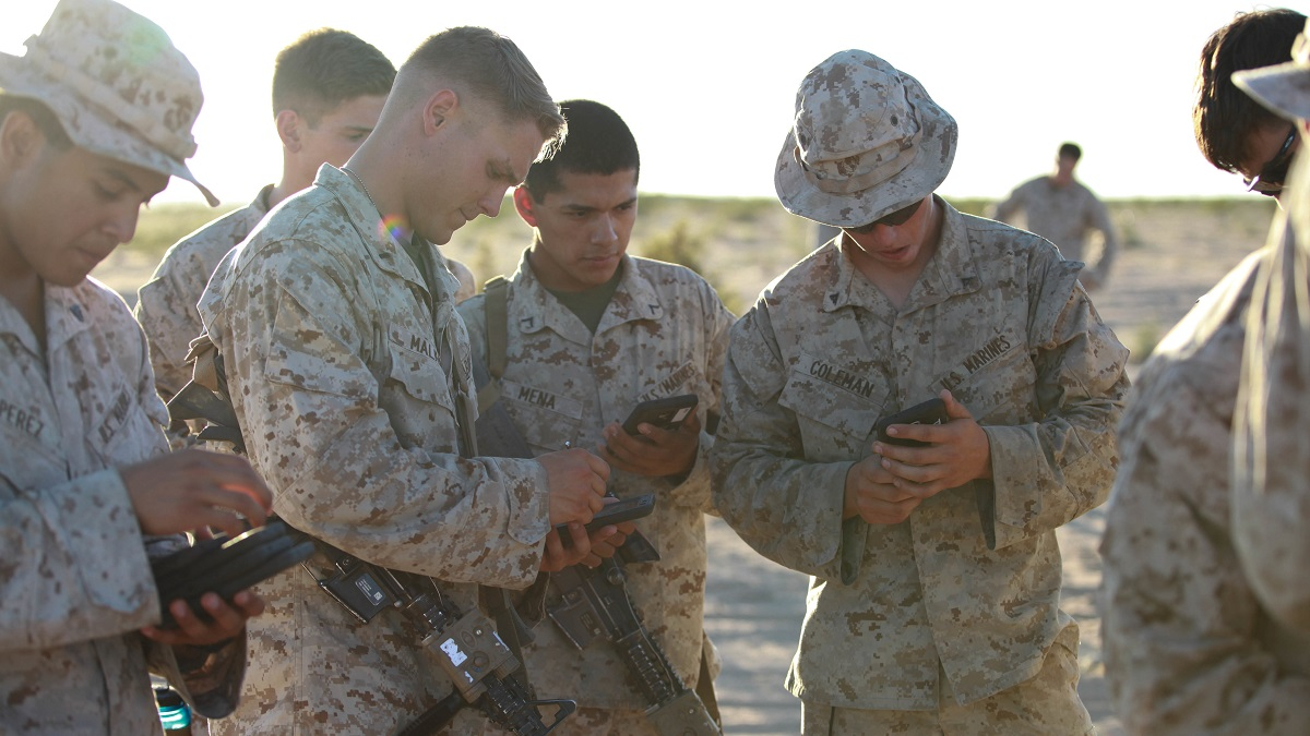 Marines with Fox Company, 2nd Battalion, 7th Marine Regiment use tablets to help them in a training exercise at Marine Corps Air Station Yuma, Ariz., Oct. 14, 2015. The tablets are wirelessly connected through an encrypted internal Wi-Fi network allowing Marines to coordinate and maneuver more efficiently in a tactical environment while securely using various applications on the devices.