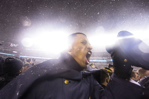 An Army cadet celebrates on the field after the U.S. Military Academy's second-straight rivalry win over Navy. (Matt Rourke/AP)