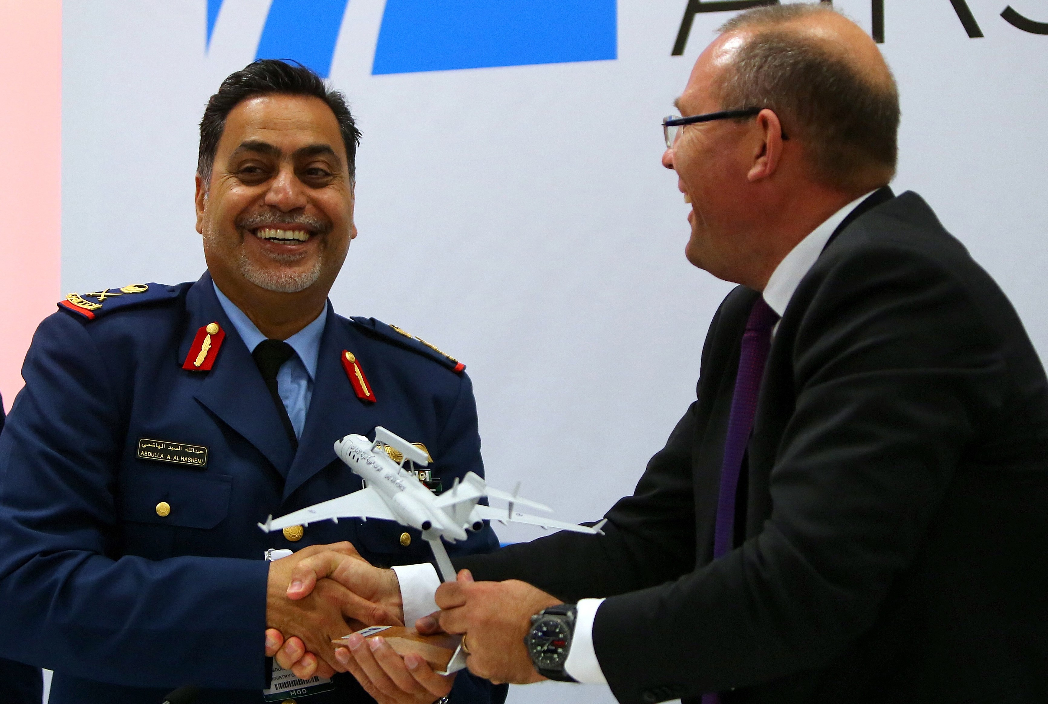 United Arab Emirates (UAE) Ministry of Defence's executive director of strategic analysis, Major General Abdullah al-Hashimi (L), receives a model of the surveillance plane Saab Global 6000 from Saab president and chief executive officer, Hakan Buskhe, at the Dubai Airshow in November 2015. The company says the first aircraft will be delivered in April 2020. (Marwan Naamani/AFP/Getty Images)