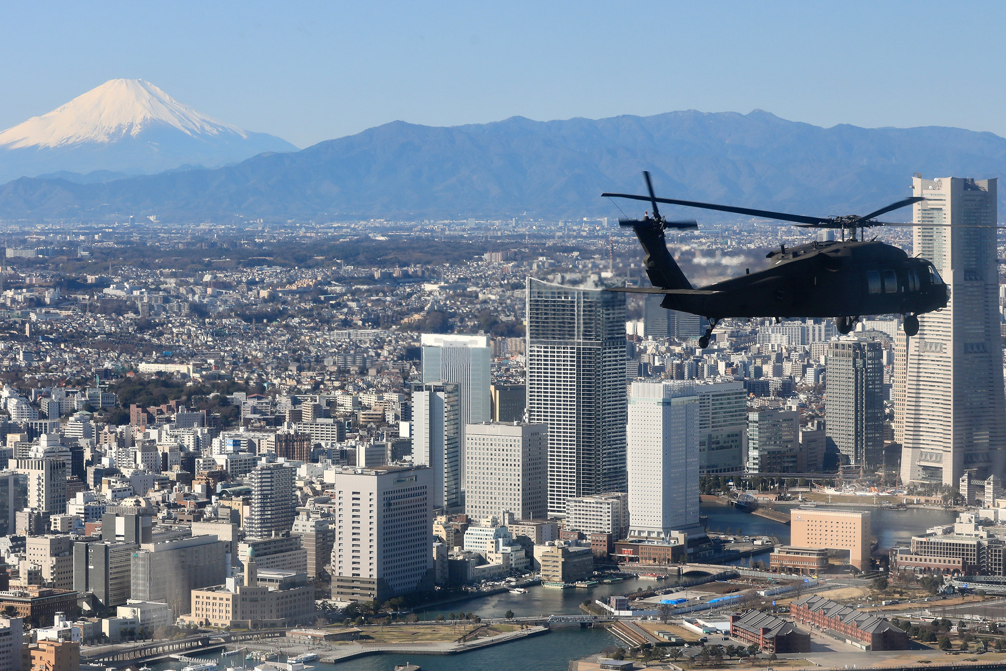 Soldiers with U.S. Army Aviation Battalion Japan soar the skies in a UH-60 Black Hawk Helicopter during a joint training exercise with Japan Ground Self-Defense Force members to rehearse tactical flight operations at Camp Zama, Japan, Jan. 9, 2020. (Sgt. Raquel Villalona/Army)