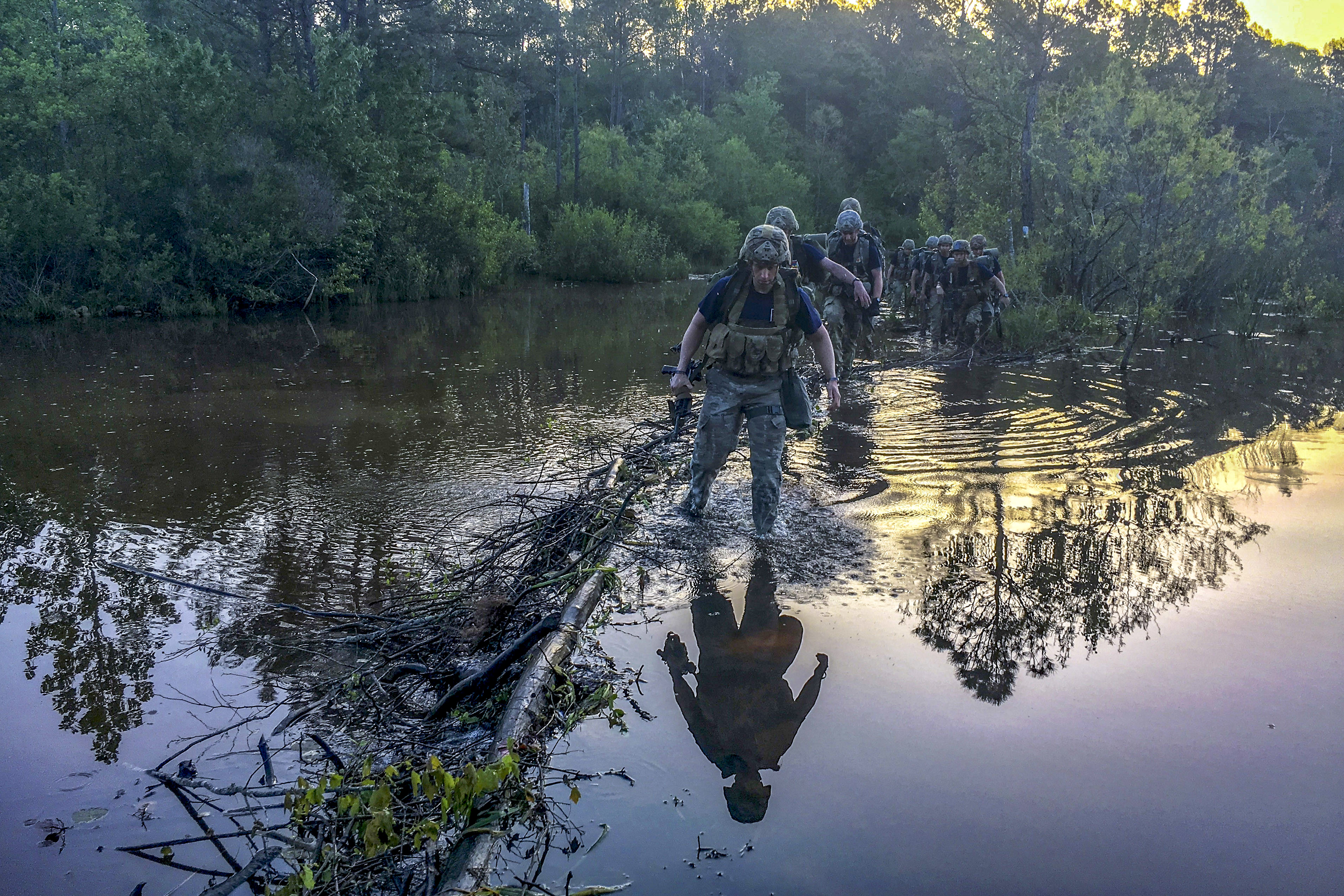 Paratroopers from 5th Squadron, 73rd Cavalry Regiment cross a river during the 3rd Brigade Combat Team, 82nd Airborne Division's May Best Squad Competition. (Maj. Thomas Cieslak/Army)