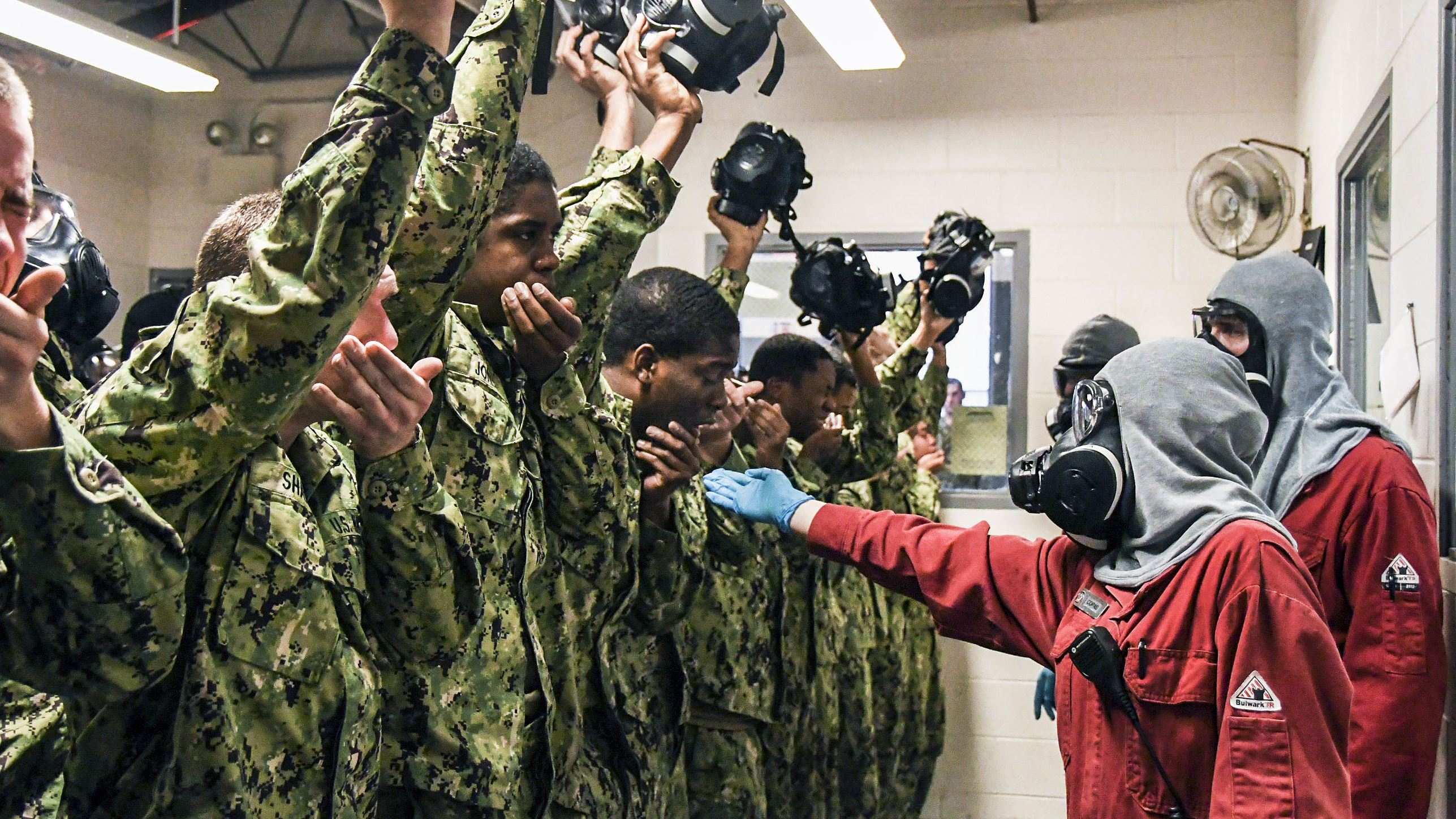 Navy recruits recite their names and division numbers while experiencing the effects of tear gas at Recruit Training Command in Great Lakes, Ill., Jan. 10, 2018. Navy photo by Amanda S. Kitchner