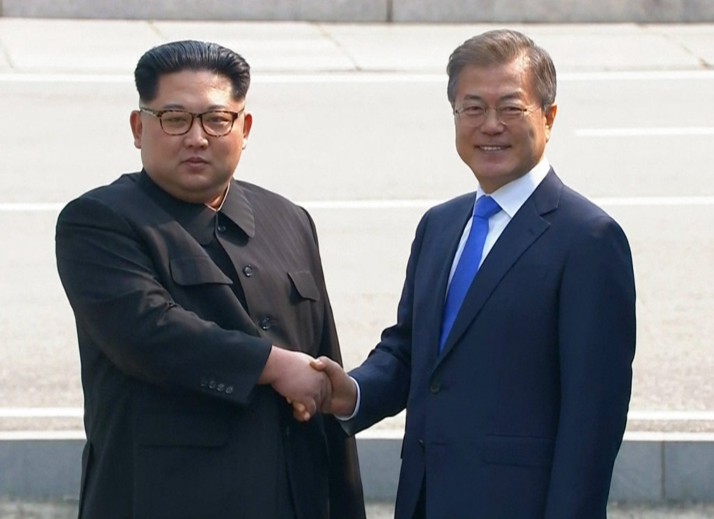 In this image taken from video provided by Korea Broadcasting System (KBS) Friday, April 27, 2018, North Korean leader Kim Jong Un, left, shakes hands with South Korean President Moon Jae-in as Kim crossed the border into South Korea for their historic face-to-face talks, in Panmunjom. Their discussions will be expected to focus on whether the North can be persuaded to give up its nuclear bombs. (Korea Broadcasting System via AP)