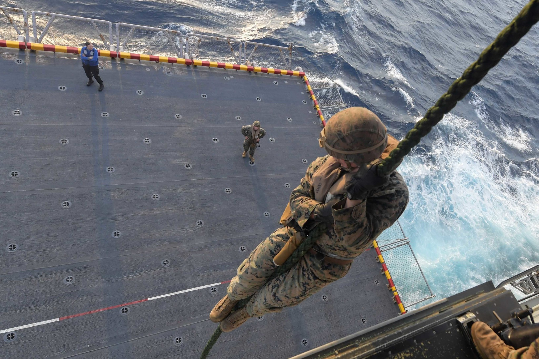 Marines perform a fast rope exercise on the port aircraft elevator of the amphibious assault ship USS America (LHA 6) on Feb. 18, 2020, in the South China Sea. (Mass Communication Specialist Seaman Jomark A. Almazan/Navy)
