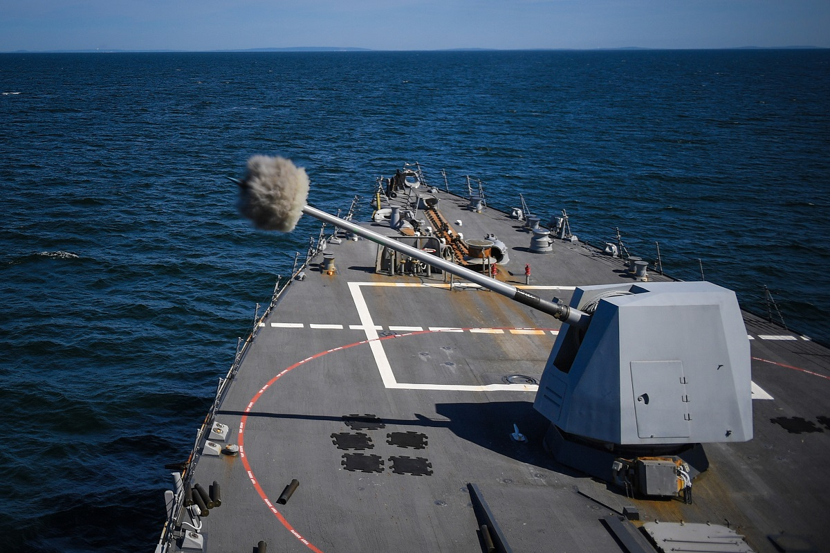 The Arleigh Burke-class destroyer Bainbridge fires its 5-inch gun during naval surface fire support for BALTOPS 2018 on June 7. (Theron J. Godbold/U.S. Navy)