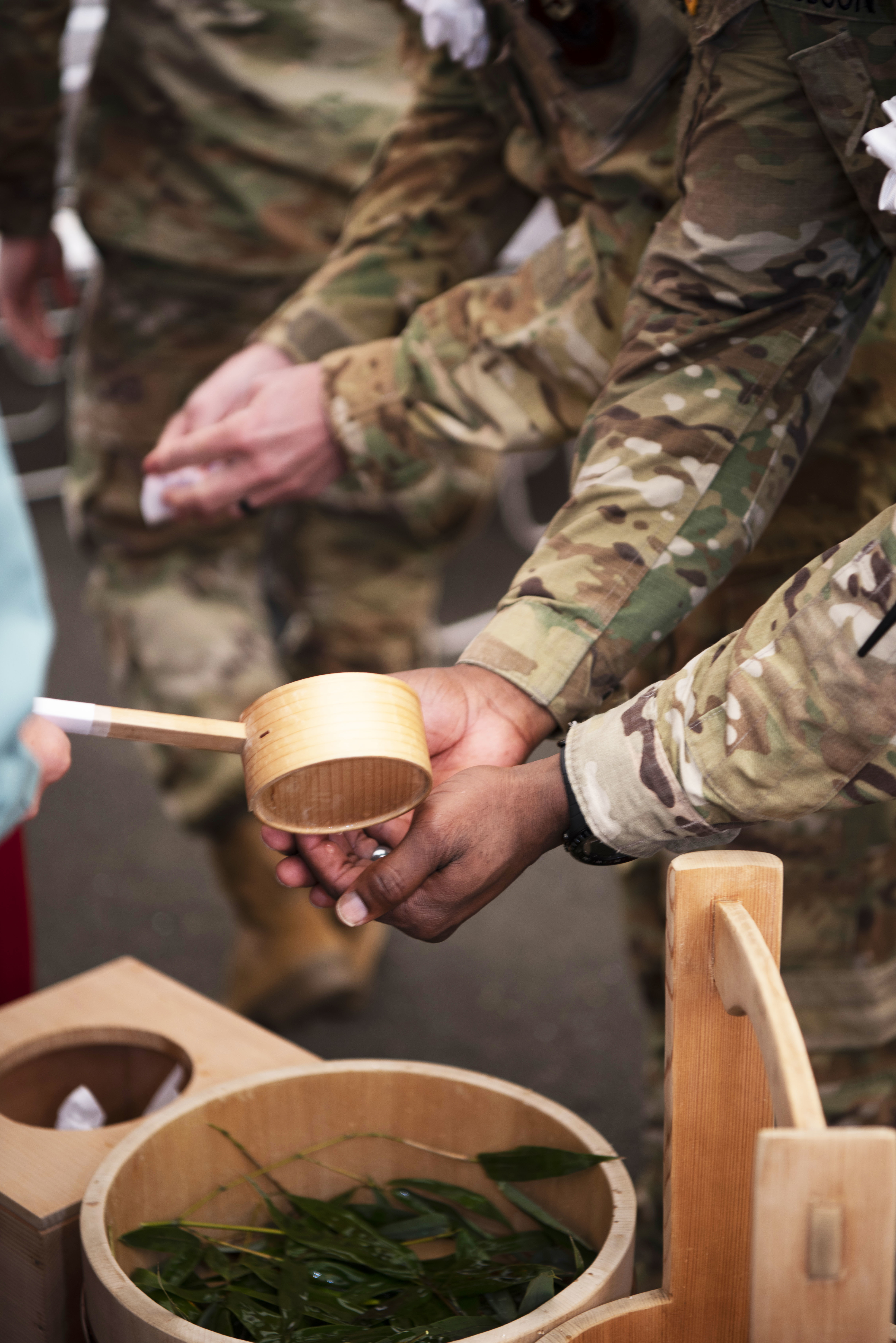 Col. Calvin Hudson, U.S. Army Global Combatant Command engineer, washes his hands before entering the Air Force Special Operations Command airfield apron ground breaking ceremony held at Yokota Air Base, Japan, Dec. 5, 2019. Every attendee who entered the sacred space was required to wash their hands in observance of Shinto traditions. (Staff Sgt. Taylor Workman/Air Force)