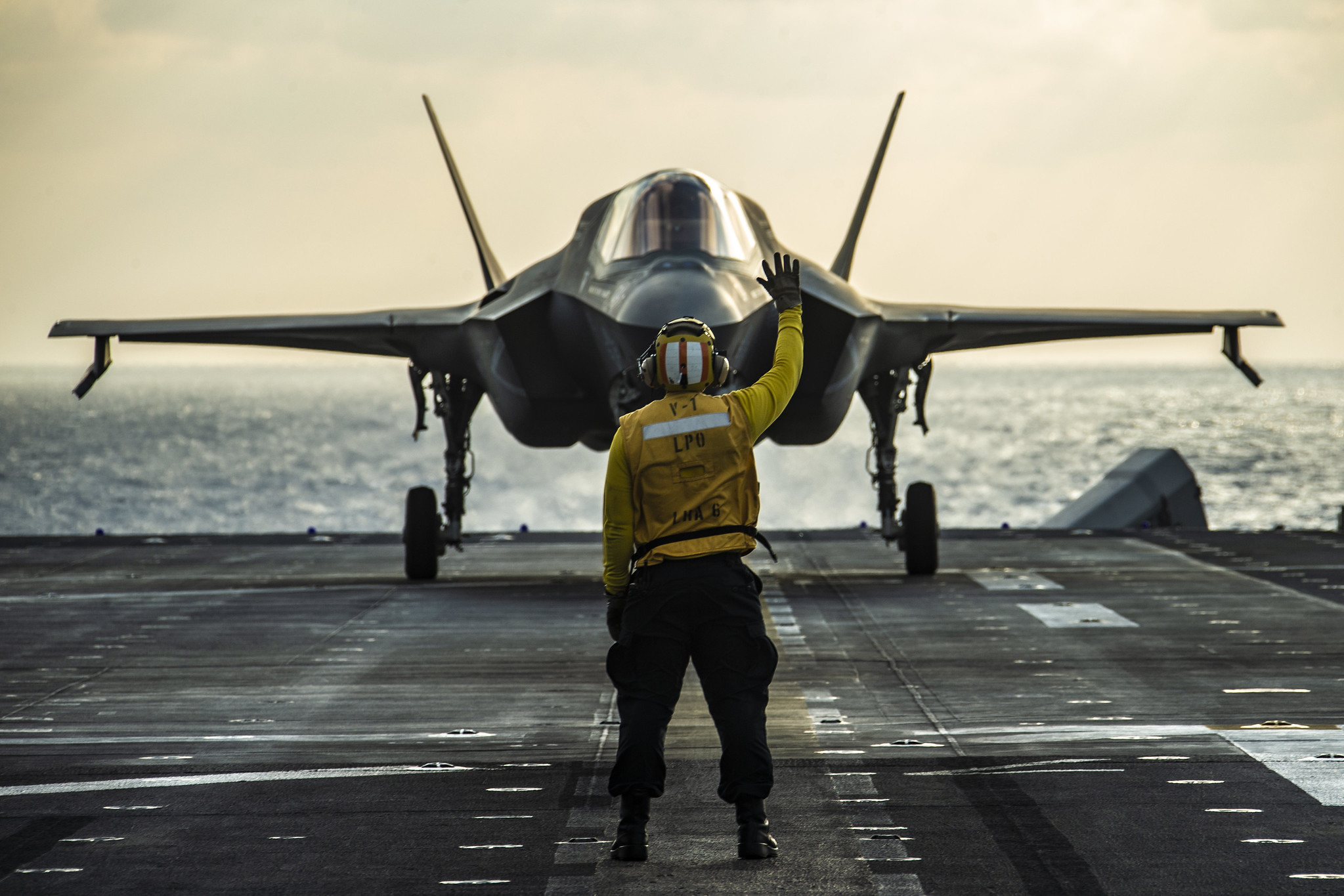 An F-35B Lightning II fighter aircraft prepares to take off from the flight deck of amphibious assault ship USS America (LHA 6) on March 25, 2020, prior to a strike exercise of an inflatable maritime target in the Philippine Sea. (Lance Cpl. Joshua Brittenham/Marine Corps