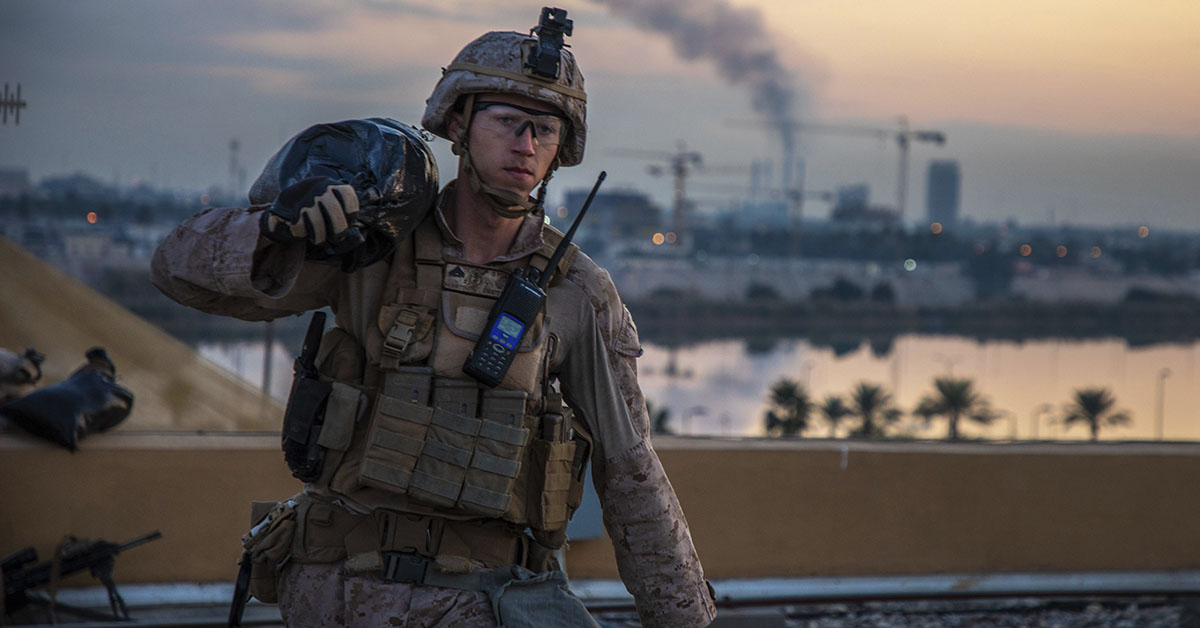 In this Saturday, Jan. 4, 2020, photo, released by the U.S. military, a U.S. Marine with 2nd Battalion, 7th Marines that is part of a quick reaction force, carries a sand bag during the reinforcement of the U.S. embassy compound in Baghdad, Iraq. The blowback over the U.S. killing of a top Iranian general mounted Sunday, Jan. 5 as Iraq's Parliament called for the expulsion of American troops from the country — a move that could allow a resurgence of the Islamic State group. (U.S. Marine Corps photo by Sgt. Kyle C. Talbot via AP)