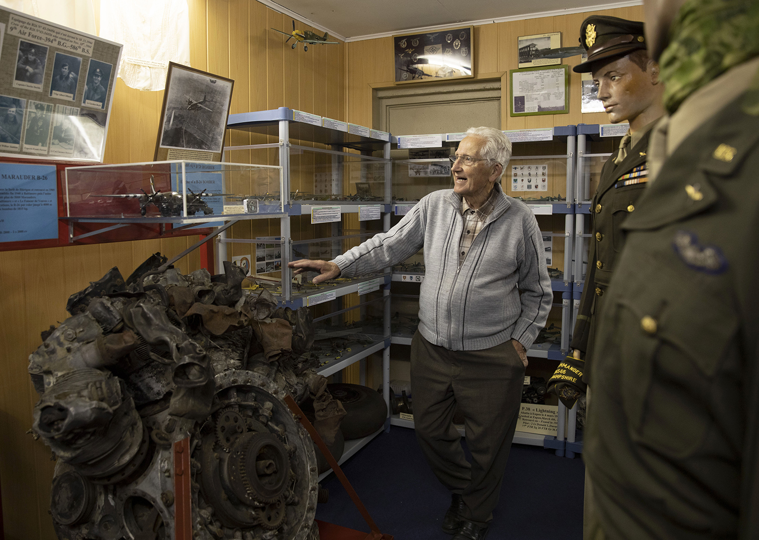 In this photo taken on Thursday, Nov. 7, 2019, Marcel Schmetz shows the motor of a crashed World War II Marauder B-26 at the Remember Museum 39-45 in Thimister-Clermont, Belgium. (Virginia Mayo/AP)