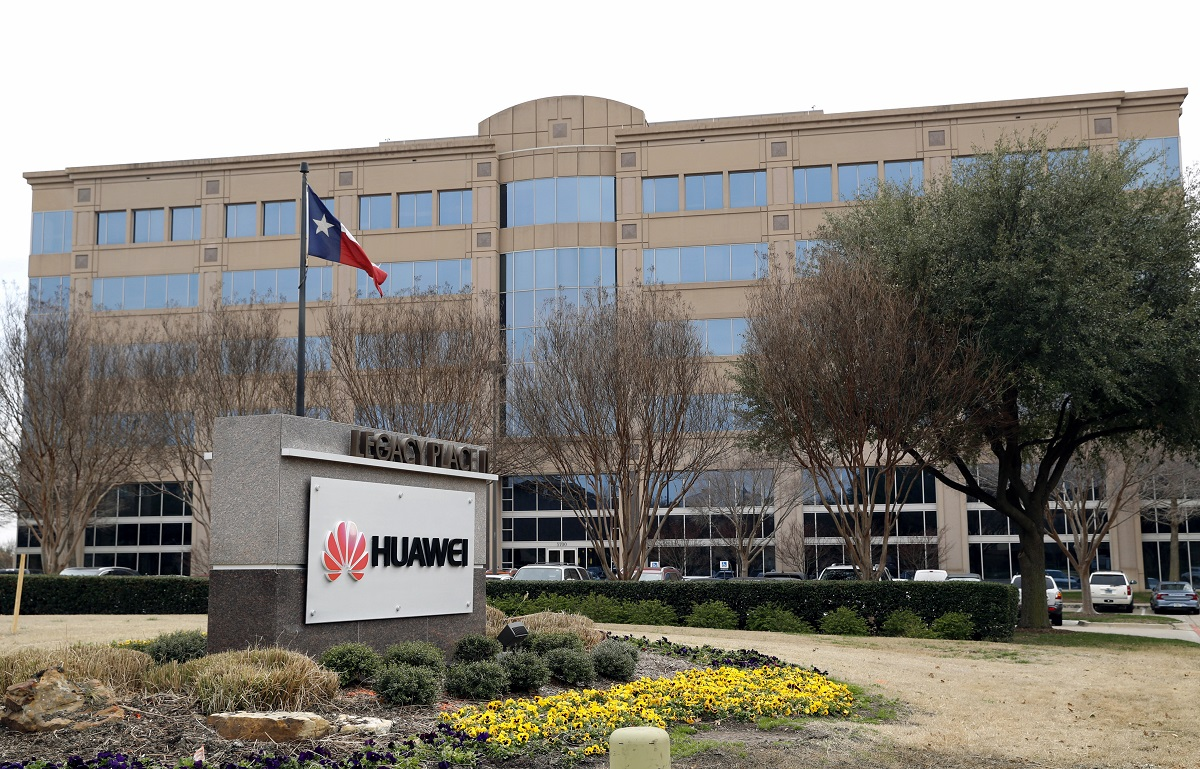 In this March 7, 2019, photo, the Texas state flag files outside the Huawei Technologies Ltd. business location in Plano, Texas. President Donald Trump issued an executive order Wednesday, May 15, 2019, apparently aimed at banning equipment from Chinese telecommunications giant Huawei from U.S. networks. It does not name specific countries or companies and gives the Department of Commerce 150 days to come up with regulations. (Tony Gutierrez/AP)