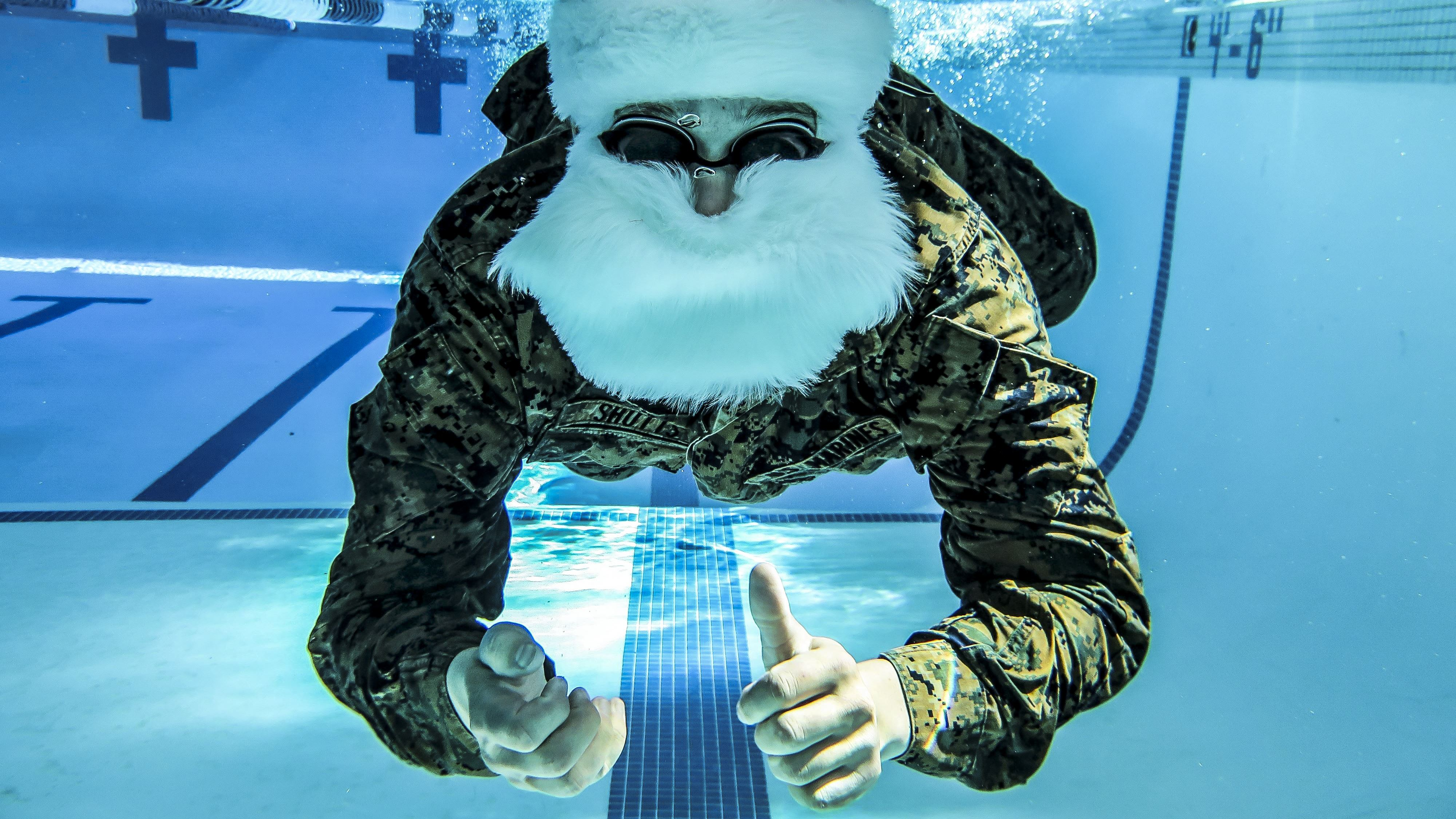Santa Claus, commanding officer of Holiday Cheer, Northpolecom, conducts basic swim qualifications at Camp Pendleton, Calif., Dec. 19, 2017. Claus must pass the Marine qualifications every two years. Marine Corps photo by Gunnery Sgt. Evan Ahlin