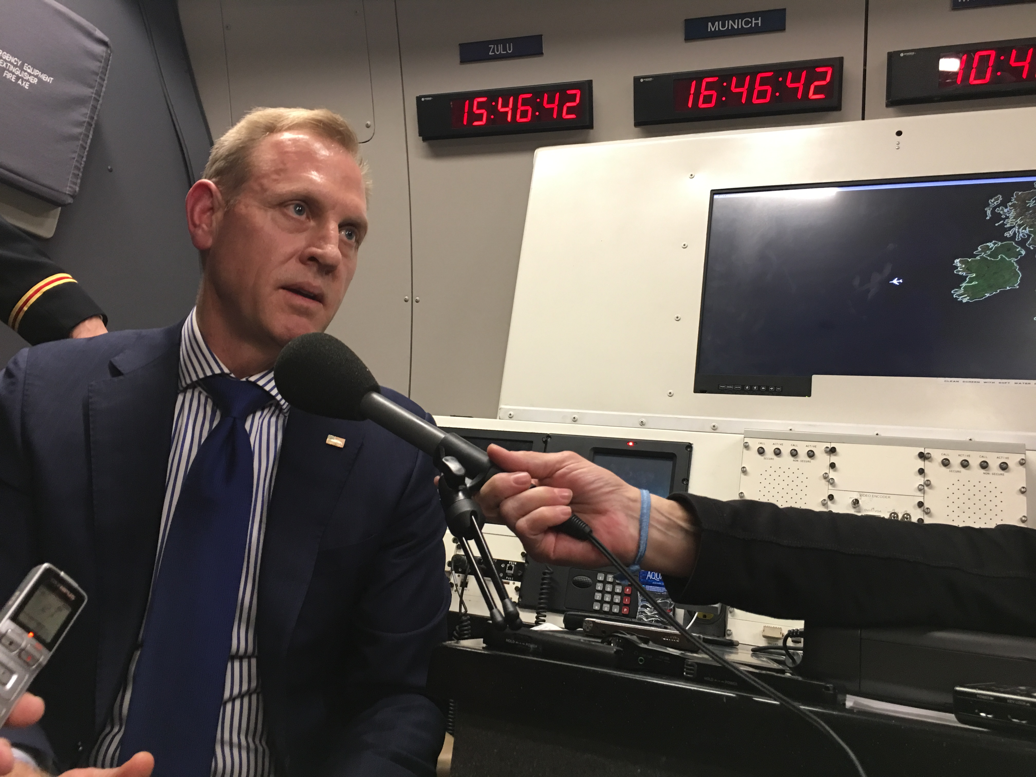 Acting Defense Secretary Patrick Shanahan briefs reporters on his deliberations on the border wall Saturday on a flight back from the Munich Security Conference. Tara Copp/Military Times