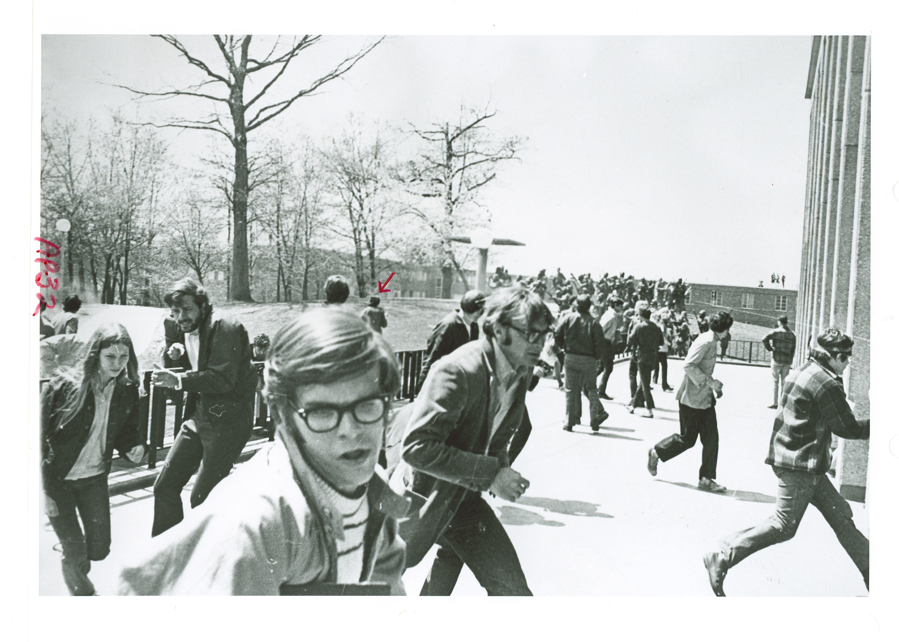 "Students run from gunfire that would kill four of their classmates at Kent State University in Ohio on May 4, 1970. President Nixon's Commission on Campus Unrest concluded ""the indiscriminate firing of rifles into a crowd of students and the deaths that followed were unnecessary, unwarranted and inexcusable."" A federal grand jury indicted eight National Guardsmen but found they were not subject to criminal prosecution because they acted in self-defense. (National Archives/Kent State investigation/Justice Department)"
