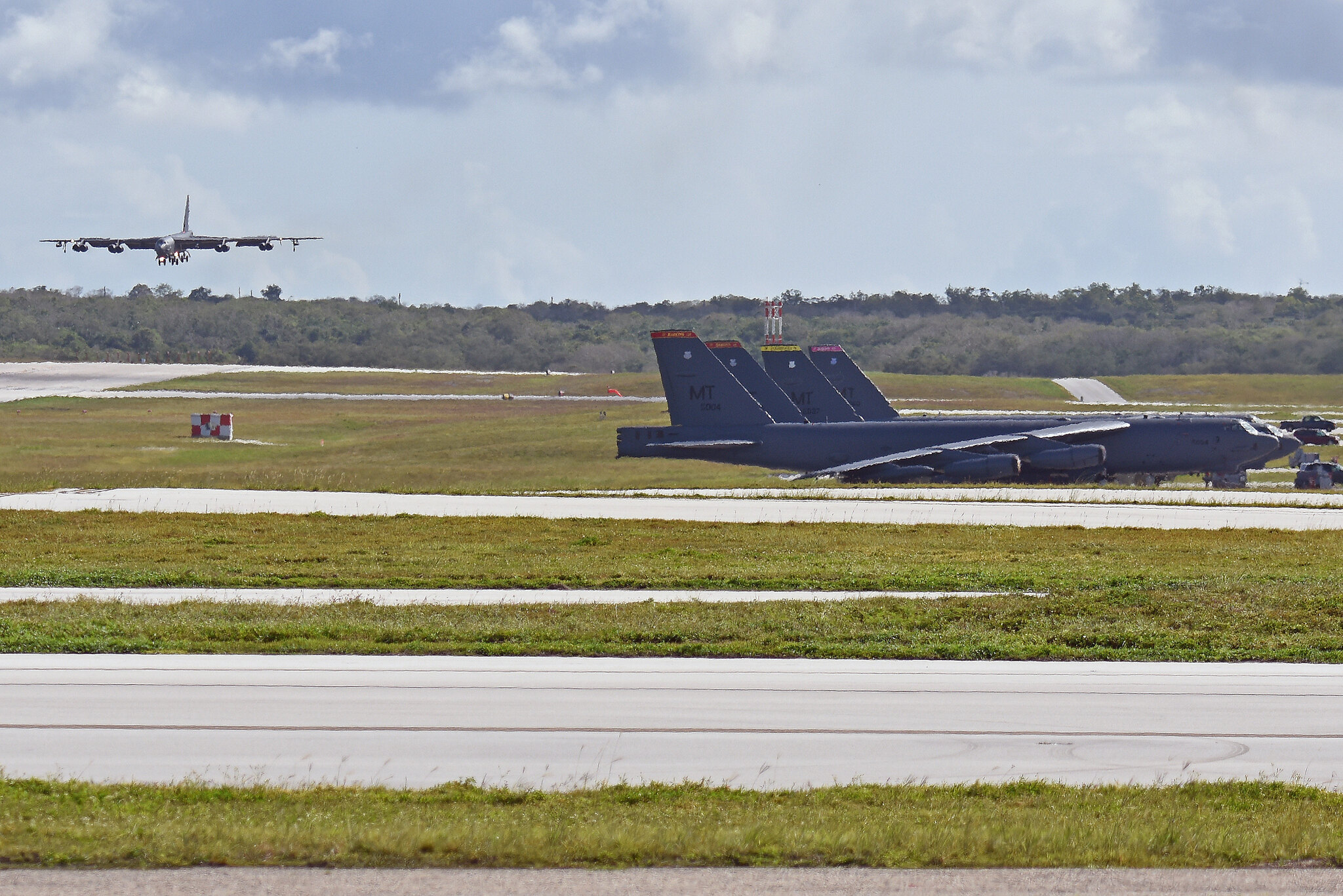A B-52 Stratofortress deployed from Minot Air Force Base, N.D., lands July 12, 2019, at Andersen Air Force Base, Guam. (Staff Sgt. Divine Cox/Air Force)