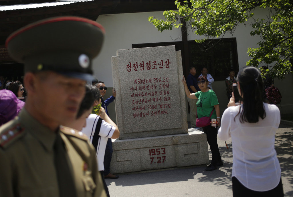 Chinese tourists have their photos taken outside the museum of the armistice agreement between North and South Korea at the truce village of Panmunjom at the Demilitarized Zone (DMZ) which separates the two Koreas in Panmunjom, North Korea, Wednesday, June 20, 2018. (Dita Alangkara/AP)