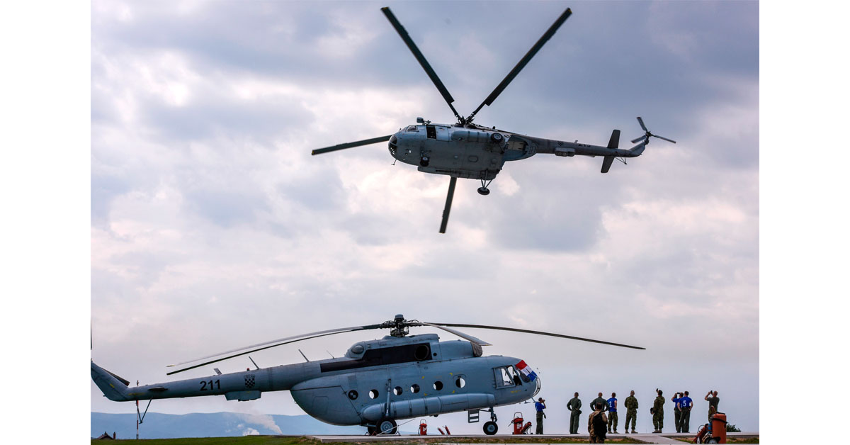 Croatian soldiers of the NATO-led peacekeeping mission in Kosovo watch as a helicopter takes off during activities marking the International KFOR Day at the military camp in Pristina on July 1, 2018. (Armend Nimani/AFP via Getty Images)