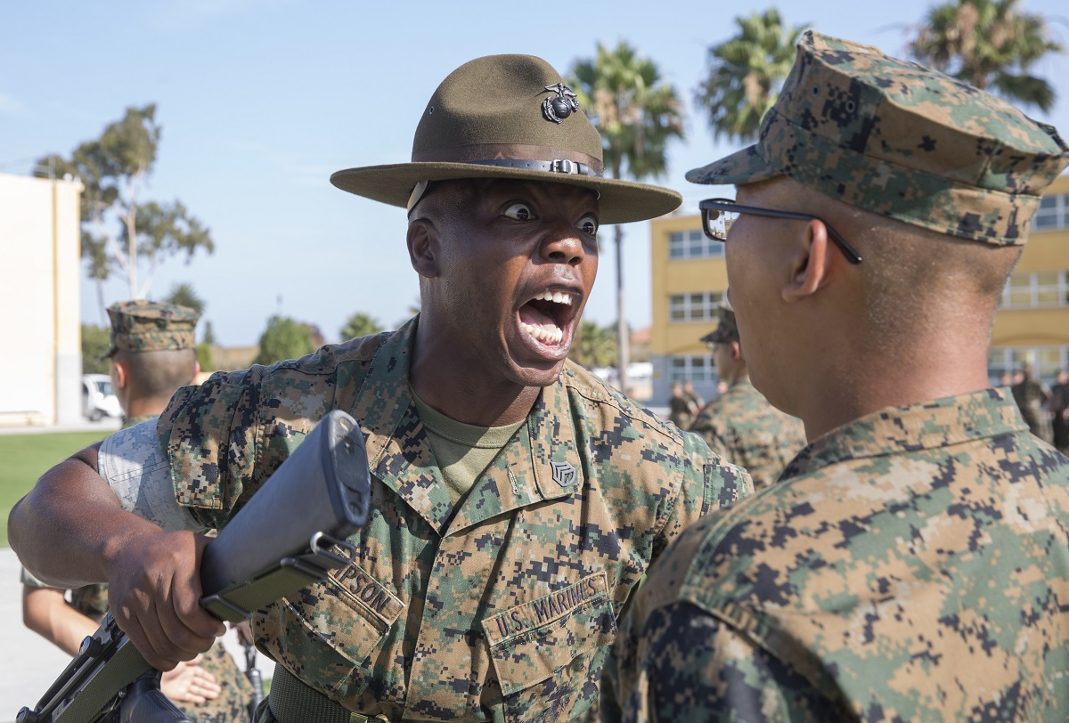 A drill instructor from Fox Company, 2nd Recruit Training Battalion, inspects a recruit's weapon during the senior drill instructor inspection at Marine Corps Recruit Depot San Diego. (Marine Corps)