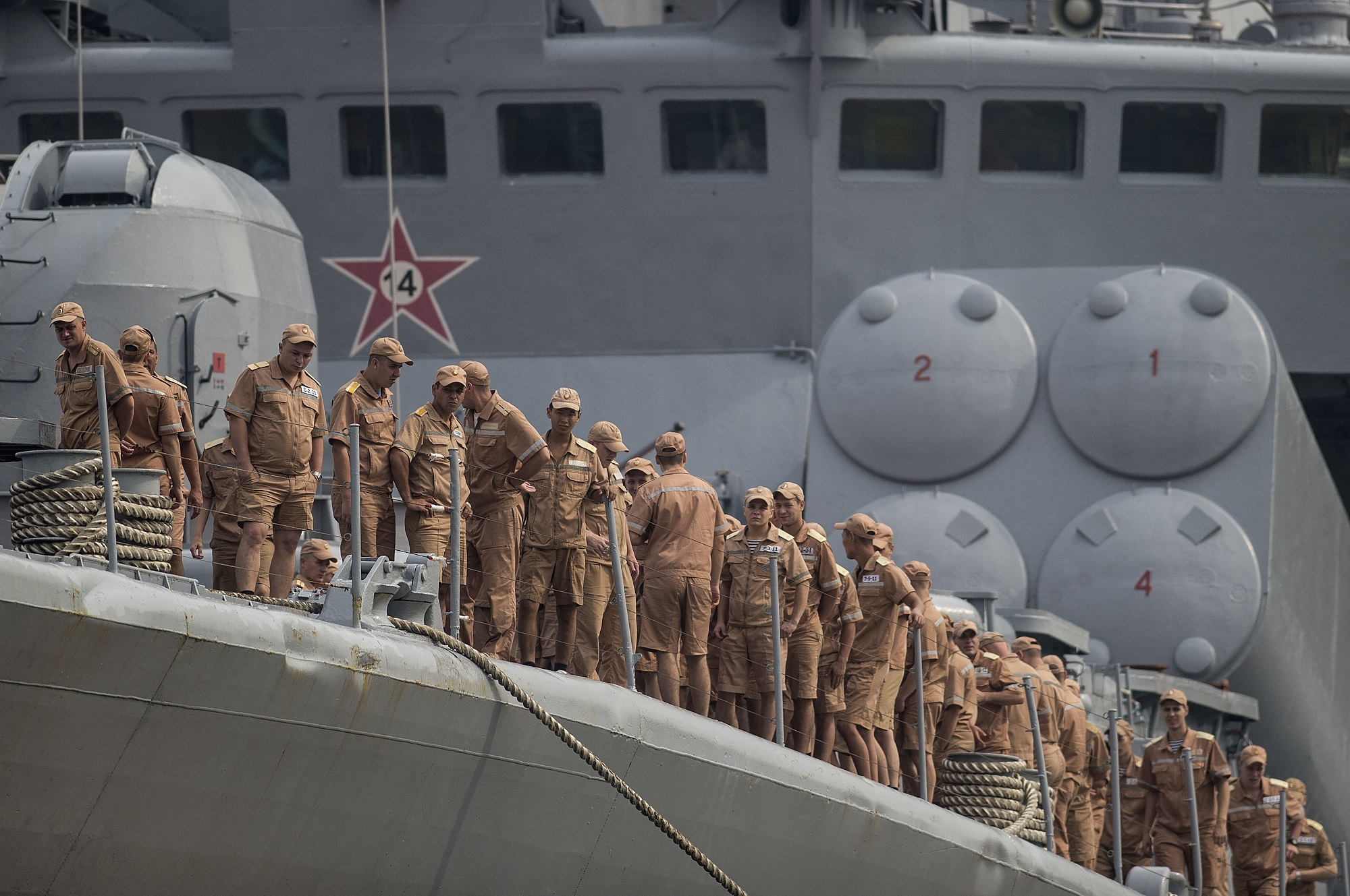 Russian sailors gather on the deck of the anti-submarine ship Admiral Vinogradov docked at the port of Manila in the Philippines on Oct. 20, 2017. (Noel Celis/AFP via Getty Images)