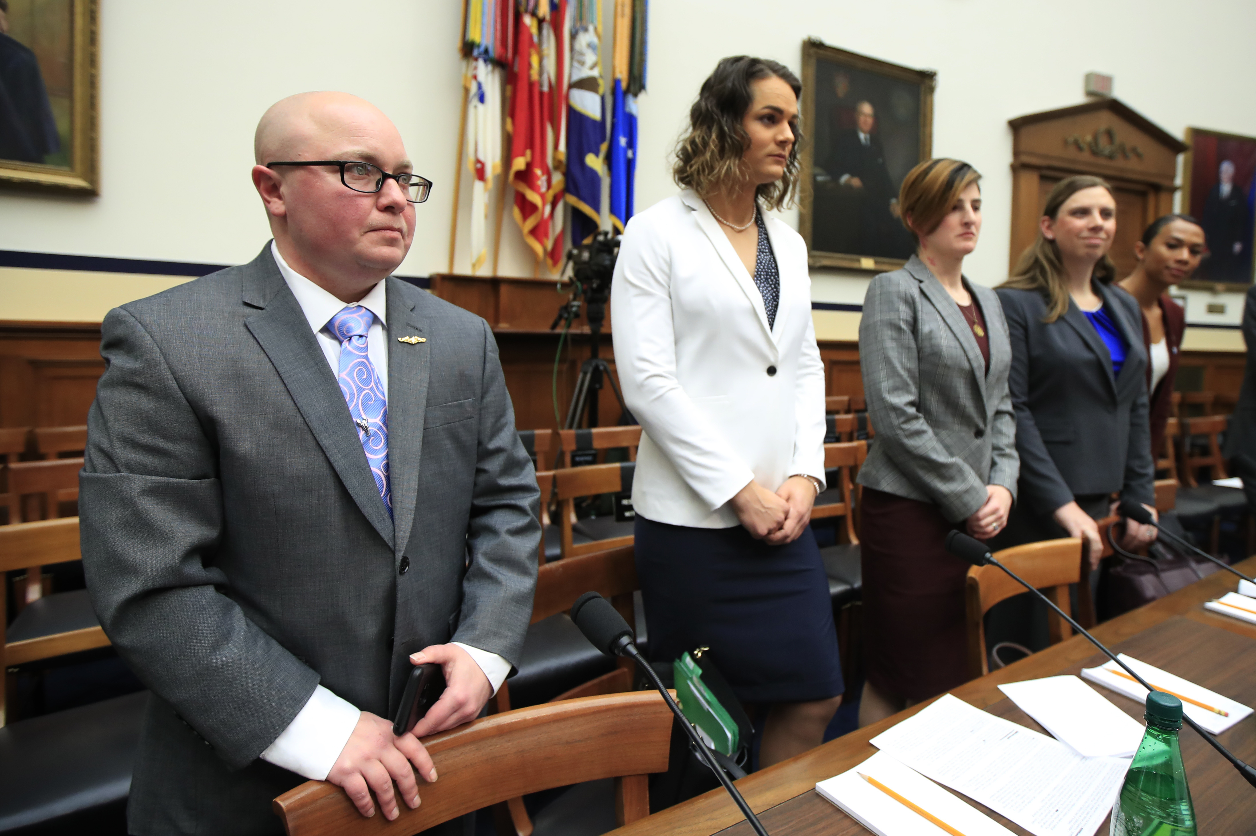 In this Feb. 27, 2019, file photo, from left, transgender military members Navy Lt. Cmdr. Blake Dremann, Army Capt. Alivia Stehlik, Army Capt. Jennifer Peace, Army Staff Sgt. Patricia King and Navy Petty Officer Third Class Akira Wyatt, listen before the start of a House Armed Services Subcommittee on Military Personnel hearing on Capitol Hill in Washington. (Manuel Balce Ceneta/AP)