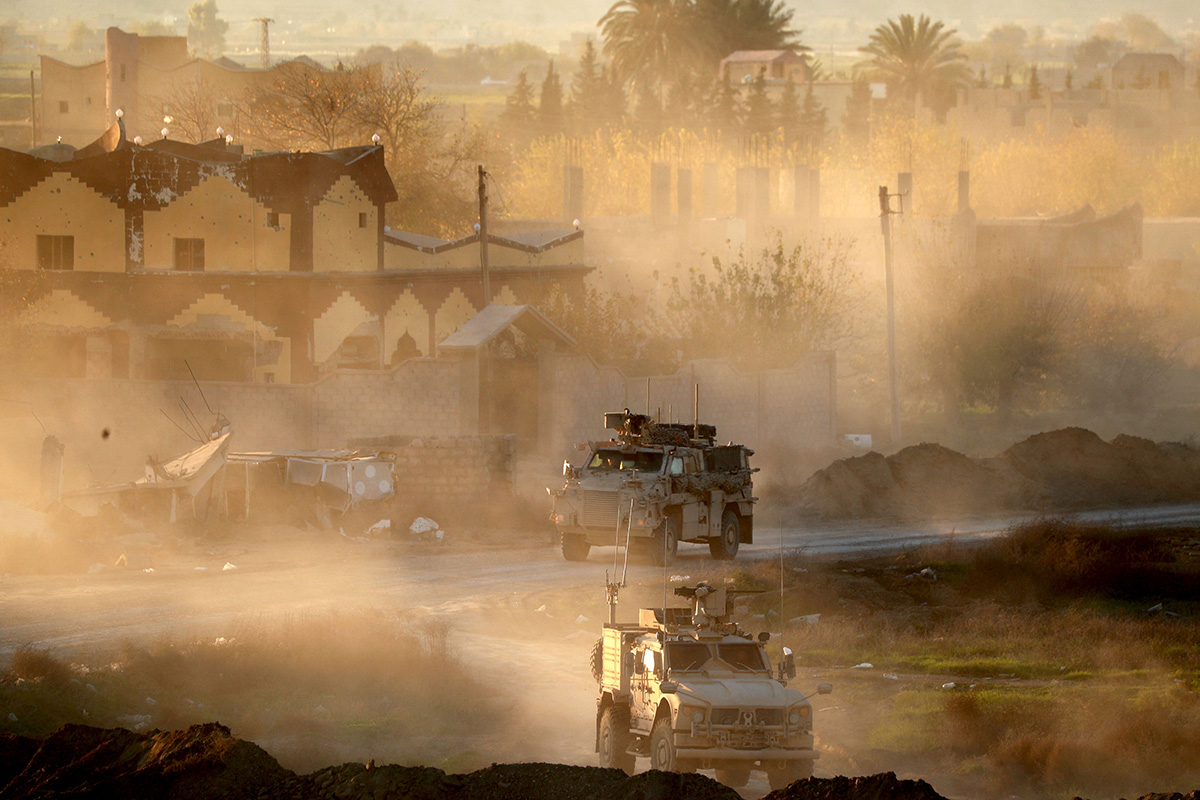 This picture shows U.S. Army vehicles supporting the Syrian Democratic Forces in Hajin, in the Deir Ezzor province, eastern Syria, on Dec. 15, 2018. (Delil Souleiman/AFP via Getty Images)