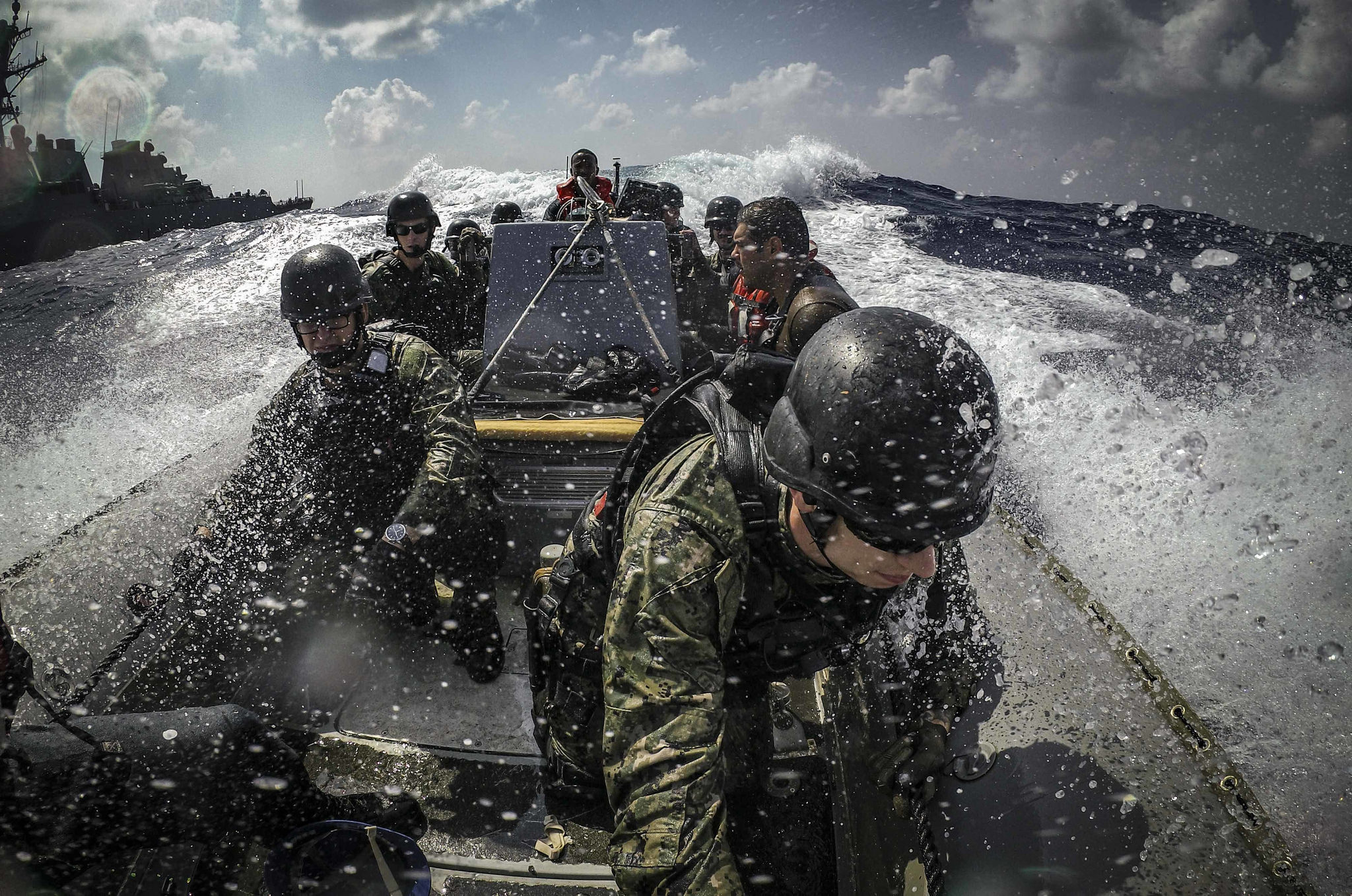 U.S. sailors maneuver a rigid-hull inflatable boat alongside the Arleigh Burke-class guided-missile destroyer USS Carney (DDG 64) while participating in visit, board, search and seizure training Sept. 10, 2018, during Exercise Bright Star 2018 in the Mediterranean Sea. (MC1 Ryan U. Kledzik/Navy)