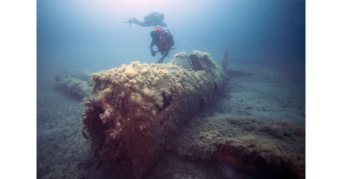 A French military diver swims July 2, 2018, above the wreck of a U.S. Army Air Force P-47 Thunderbolt (Warthog) fighter plane, which crashed in 1944 during World War II off the French Mediterranean island of Corsica. (Boris Horvat/AFP via Getty Images)