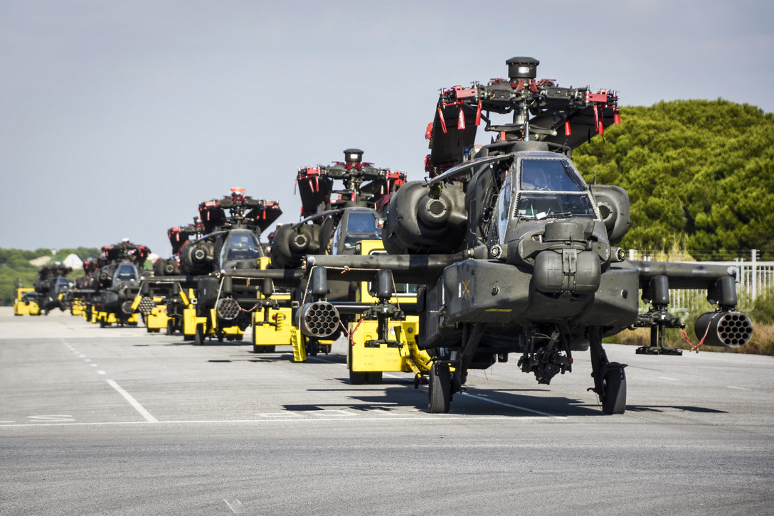 Naval Station Rota, Spain, Naval Supply Systems Command Fleet Logistics Center Sigonella, 1st Armored Division, and 1109th Theater Aviation Sustainment Maintenance Group, transport multiple AH-64D Apache helicopters Jan. 3, 2019, during helicopter intermodal operations. (MC1 Benjamin A. Lewis/Navy)