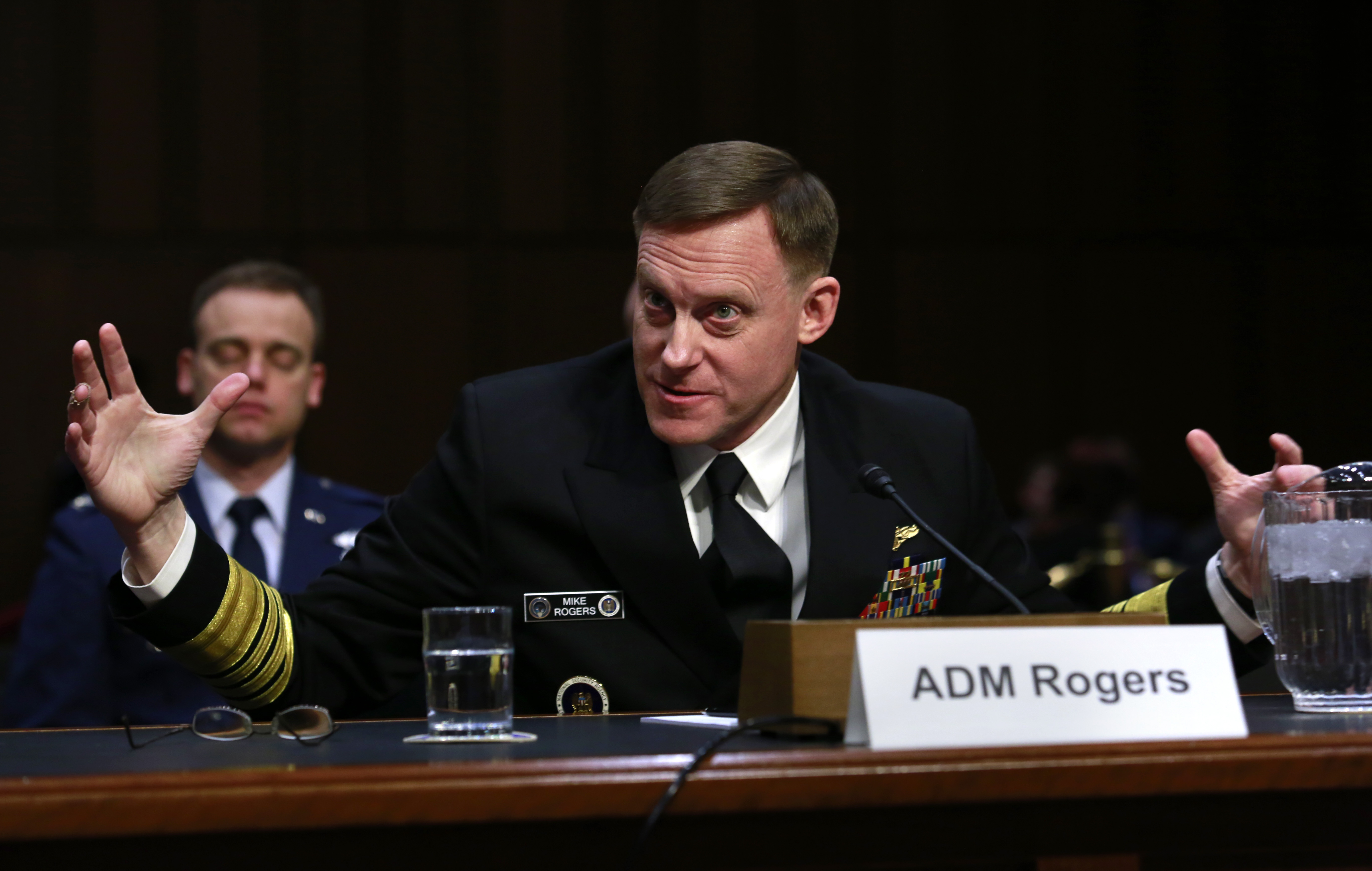 Navy Adm. Michael Rogers, commander of the U.S. Cyber Command, testifies before a Senate Armed Services Committee hearing where he discussed challenges to integrating the electronic warfare, cyber and the information dynamic, among other topics. (YURI GRIPAS/AFP/Getty Images)