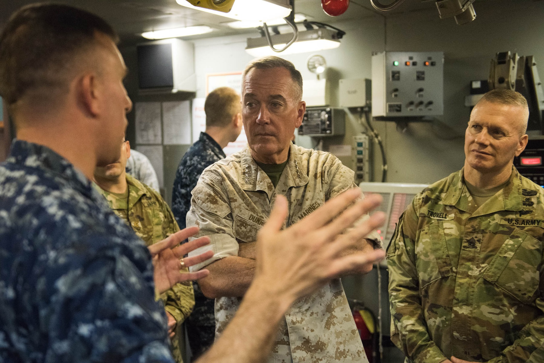 Chairman of the Joint Chiefs of Staff Gen. Joseph F. Dunford Jr., center, and his senior enlisted adviser Command Sgt. Maj. John Troxell, receive a briefing at Naval Submarine Base, Kings Bay, Ga., last year. (D. Myles Cullen/DoD)