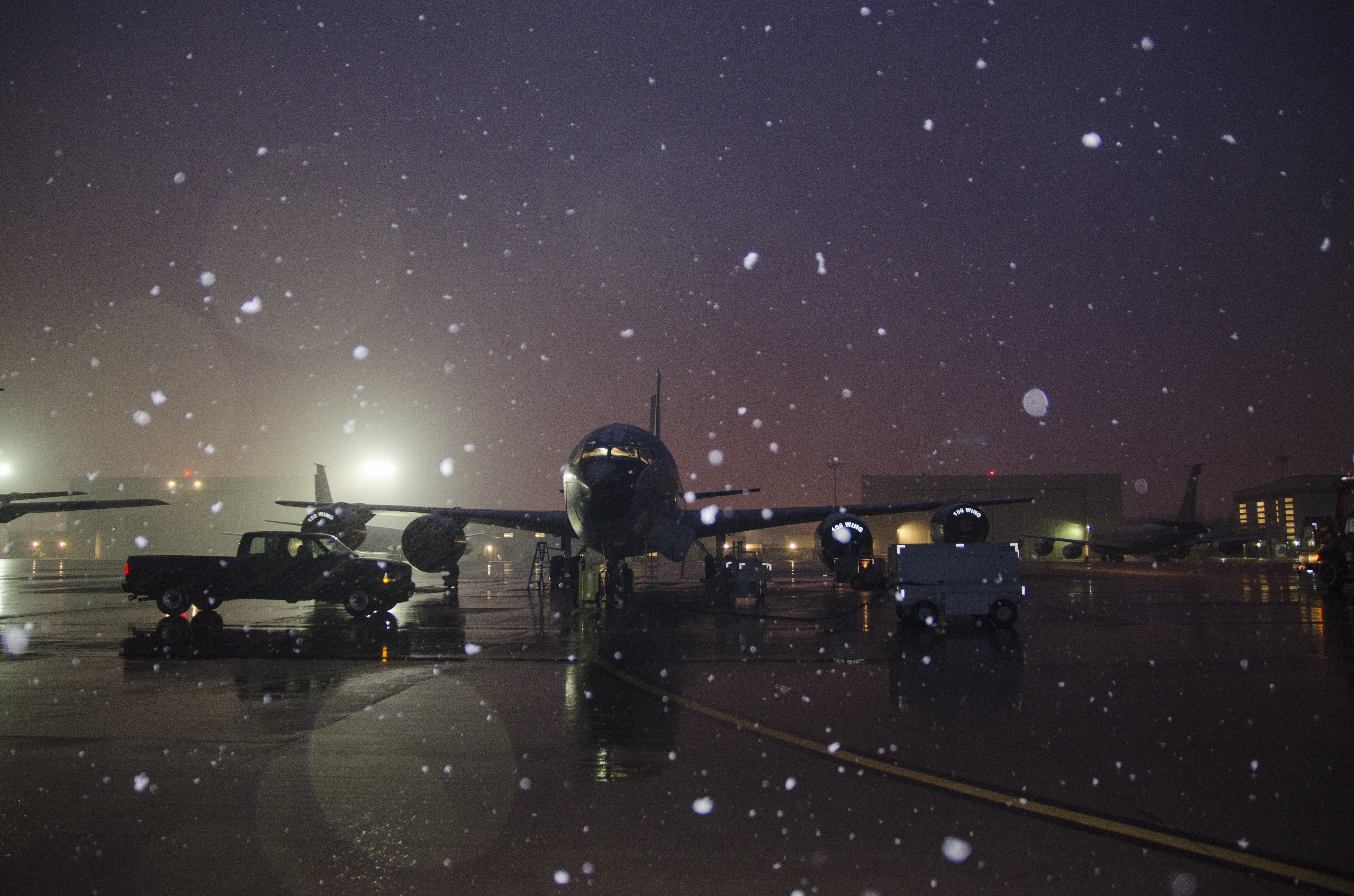 Snow falls as a 141st Air Refueling Squadron KC135R is prepped on the flightline at Joint Base McGuire-Dix-Lakehurst, N.J., Jan. 17, 2018. (Staff Sgt. Ross A. Whitley/Air National Guard)