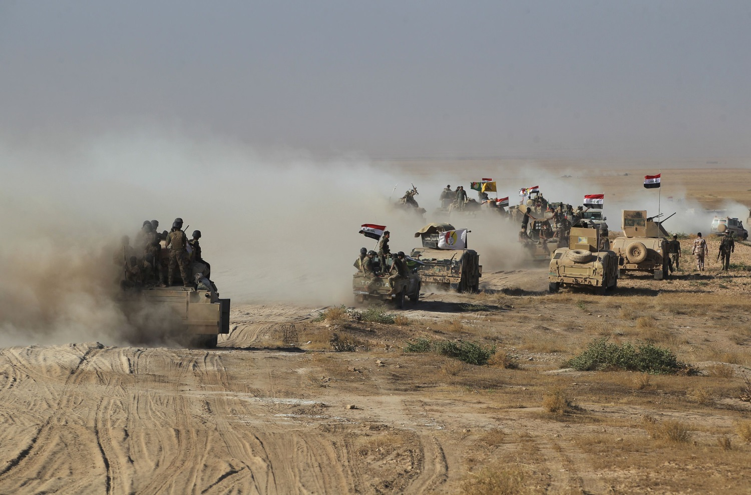 Iraqi forces backed by the Hashed Al-Shaabi (Popular Mobilization units) advance towards the town of Tal Afar, west of Mosul, after the Iraqi government announced the beginning of the operation to retake it from the control of the Islamic State group on Aug. 22, 2017. (Ahmad Al-Rubaye/ AFP via Getty Images)