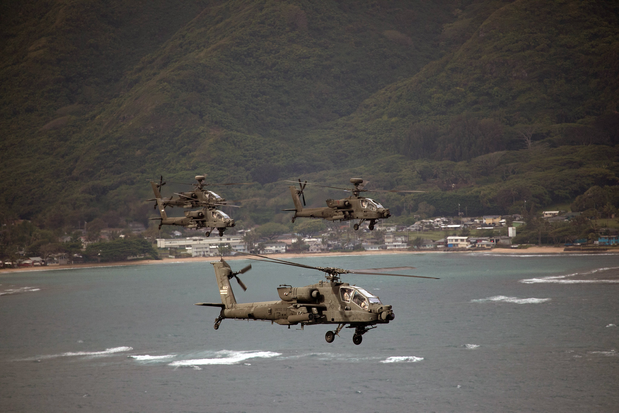 The 25th Combat Aviation Brigade, 25th Infantry Division flies 19 AH-64 Apache helicopters in an organized formation around Oahu on May 1, 2019. (Sgt. Ryan Jenkins/Army)