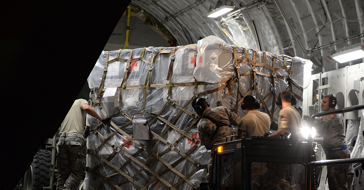 Members of the 60th Aerial Port Squadron at Travis Air Force Base, Calif., load a C-17 Globemaster III Sept. 7 with two all terrain vehicles, two humvees, an all terrain forklift, four pallets of supplies and a crew. (Senior Airman Amber Carter/Air Force)