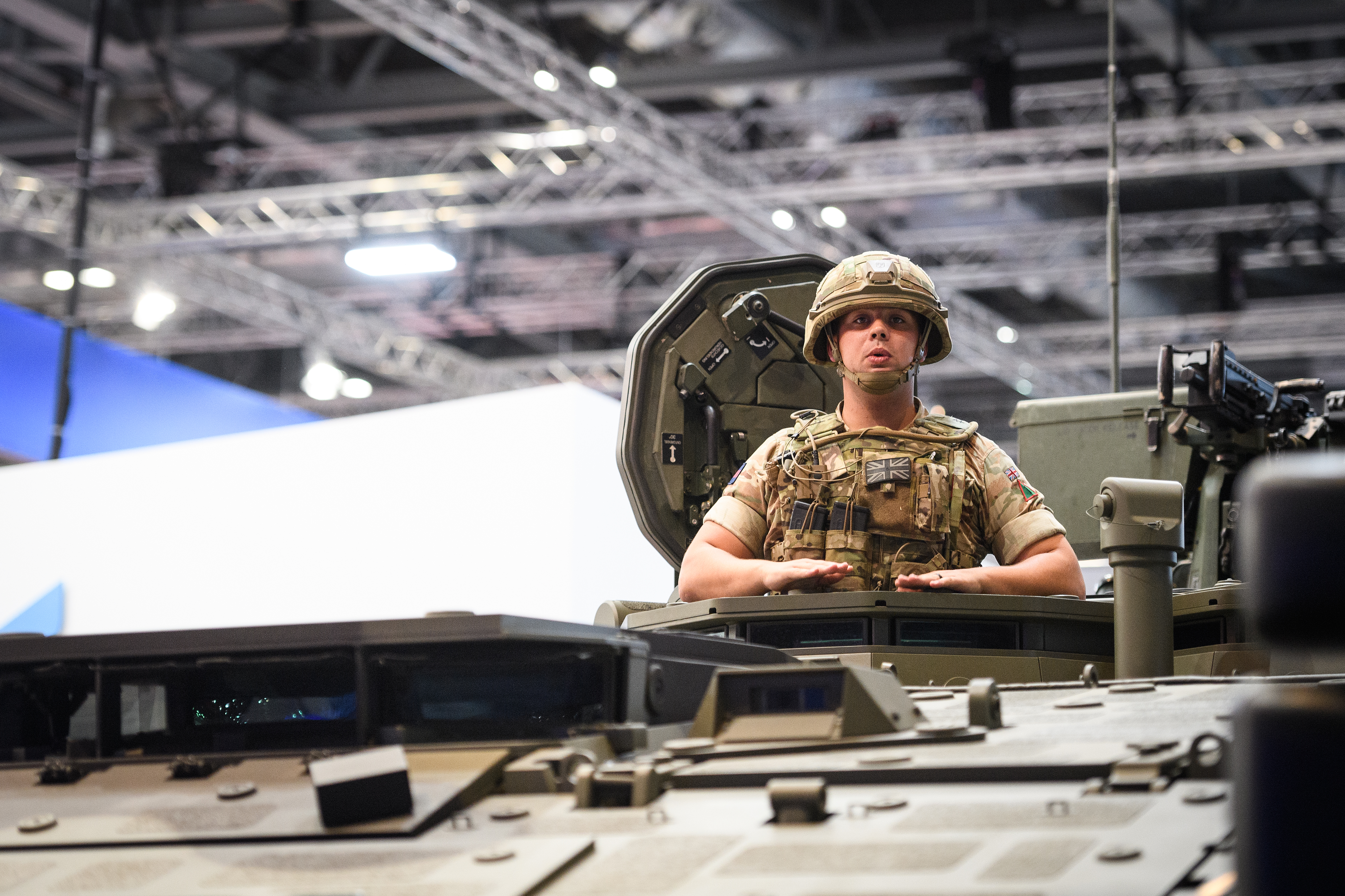 A soldier sits in a Boxer armored vehicle at the DSEI arms fair in London on Sept. 11, 2019. Held every two years, the event is the world's largest arms fair. (Leon Neal/Getty Images)