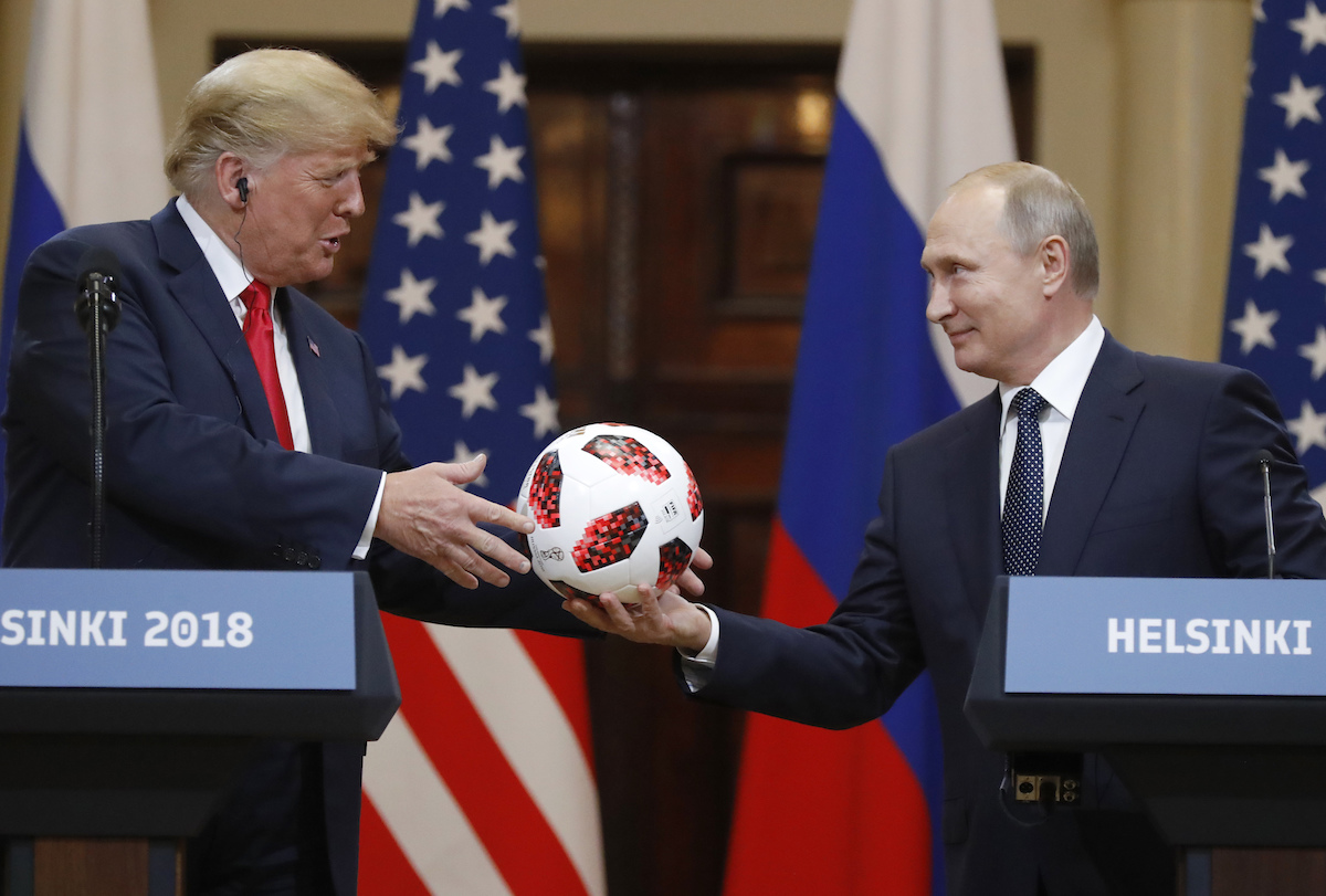Russian President Vladimir Putin gives a soccer ball to U.S. President Donald Trump, left, during a press conference after their meeting at the Presidential Palace in Helsinki, Finland, Monday, July 16, 2018. (Alexander Zemlianichenko/AP)