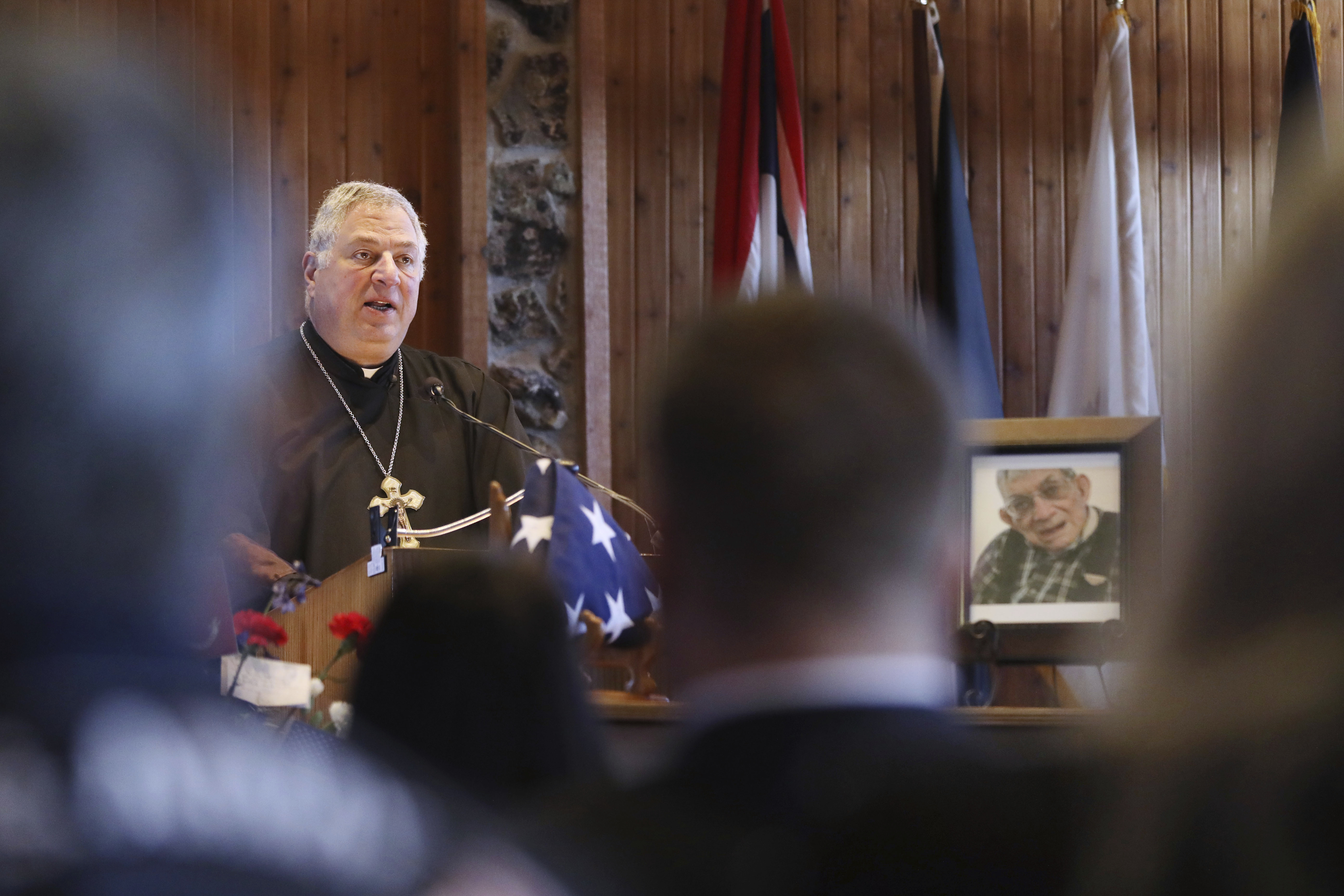 Friar Stephen Ziton officiates the funeral service for WWII Marine veteran Cpl. Remigio