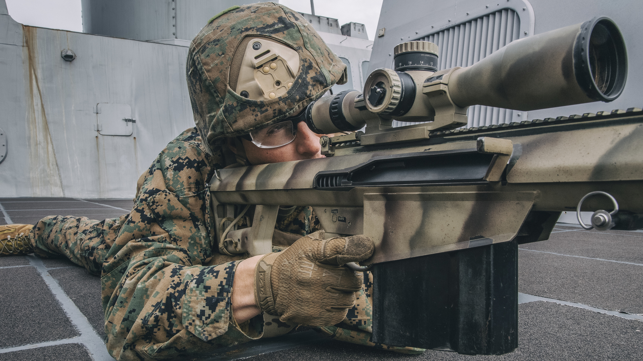 1st Lt. Nathaniel Lambert sights in behind a .50-caliber Special Applications Scoped Rifle on Feb. 20, 2019, during a simulated strait transit aboard the San Antonio-class amphibious transport dock ship USS John P. Murtha (LPD 26) in the Pacific Ocean. (Lance Cpl. Israel Chincio/Marine Corps)
