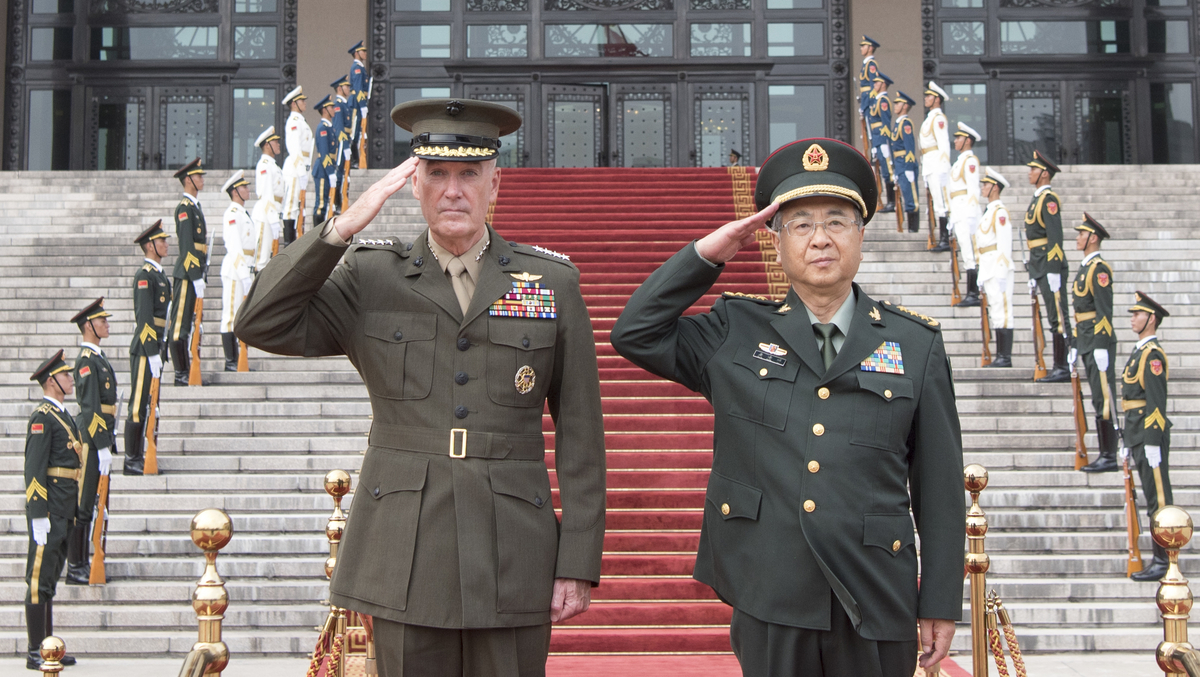 Gen. Joseph Dunford, left, chairman of the Joint Chiefs of Staff, participates in a welcome ceremony with then-Chinese counterpart Gen. Fang Fenghui at the Ba Yi on Aug. 15, 2017. Dunford has been critical of U.S. companies doing business with China. (U.S. Navy)
