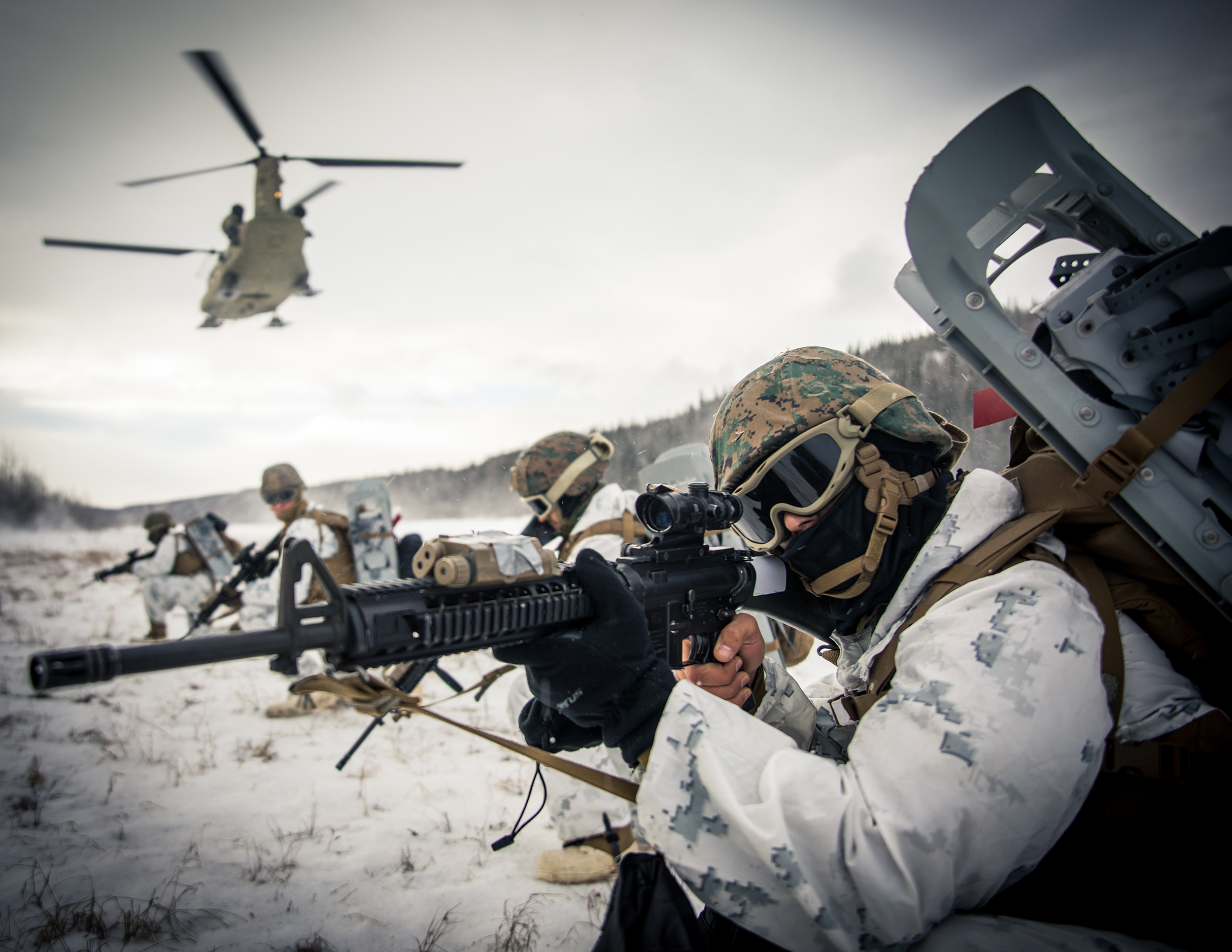 Lance Cpl. Andrew Z. Munoz, right, a motor vehicle operator with 7th Engineer Support Battalion, 1st Marine Logistic Group, provides security at Fort Greely, Alaska, Feb. 19, 2020, in preparation for exercise Arctic Edge 2020. (Lance Cpl. Jose Gonzalez/Marine Corps)
