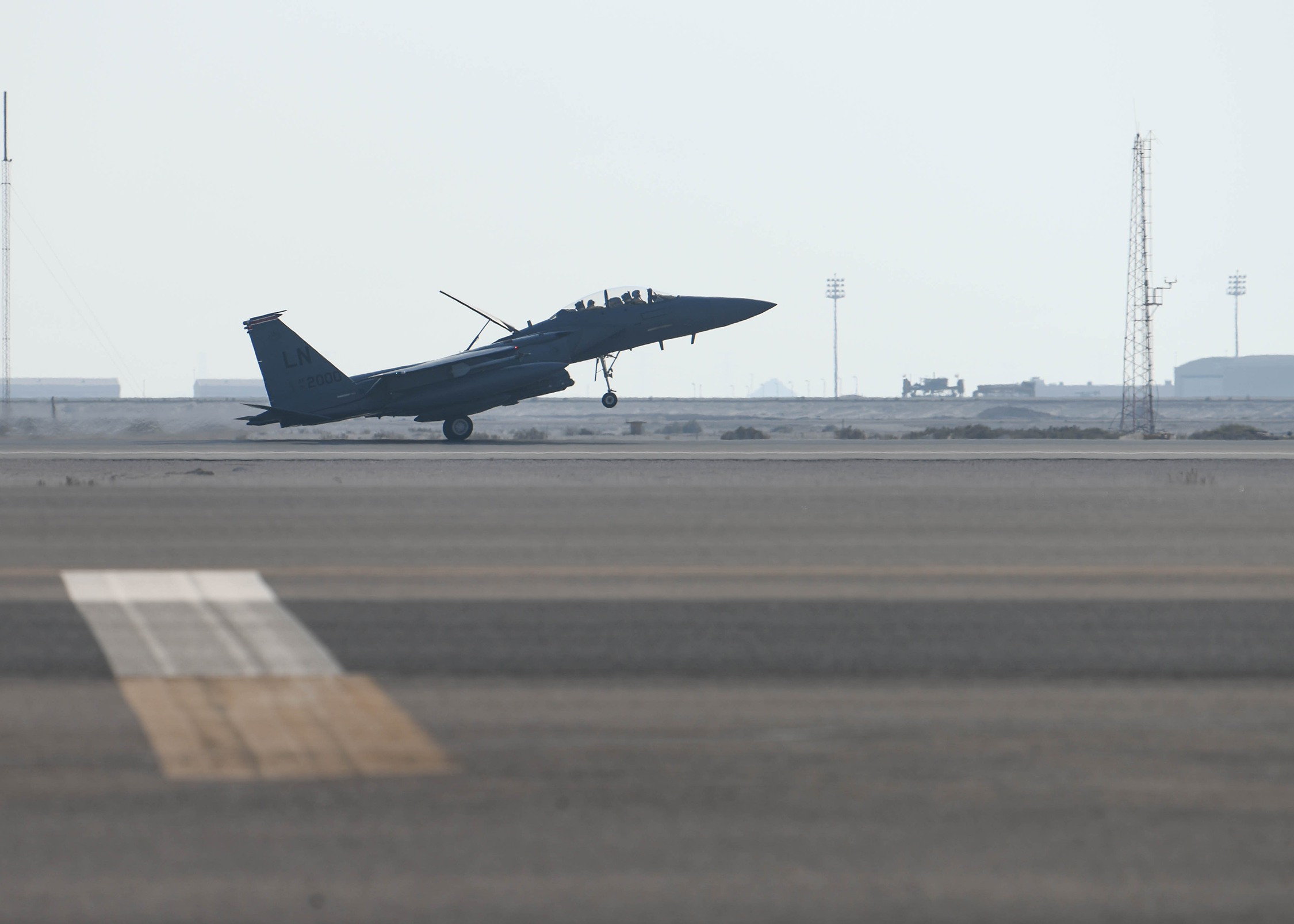 """An F-15E Strike Eagle from the 494th Fighter Squadron lands at Al Dhafra Air Base, United Arab Emirates, Oct. 18. The 494th Fighter Squadron """"Panthers"""" deployed to the Middle East to support ongoing operations to maintain air superiority, defend forces on the ground, enhance regional partnerships, and demonstrate a continued commitment to regional security and stability, the Air Force said. (Staff Sgt. Anna-kay Ellis/Air Force)"""