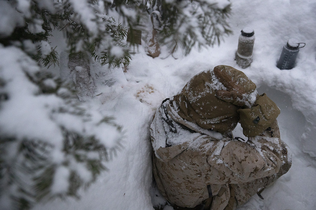 A U.S. Marine sits in a trench during advanced cold-weather training at the Marine Corps Mountain Warfare Training Center Saturday, Feb. 9, 2019, in Bridgeport, Calif. After 17 years of war against Taliban and al-Qaida-linked insurgents, the military is shifting its focus to better prepare for great-power competition with Russia and China, and against unpredictable foes such as North Korea and Iran. (Jae C. Hong/AP)