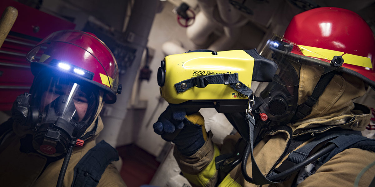Damage Controlman 3rd Class Troy Jenkins, right, uses a thermal imager during a fire drill aboard the guided-missile destroyer Donald Cook, as the ship prepared to have operations with a Turkish frigate in the Black Sea. (Mass Communication Specialist 2nd Class Ford Williams/Navy)