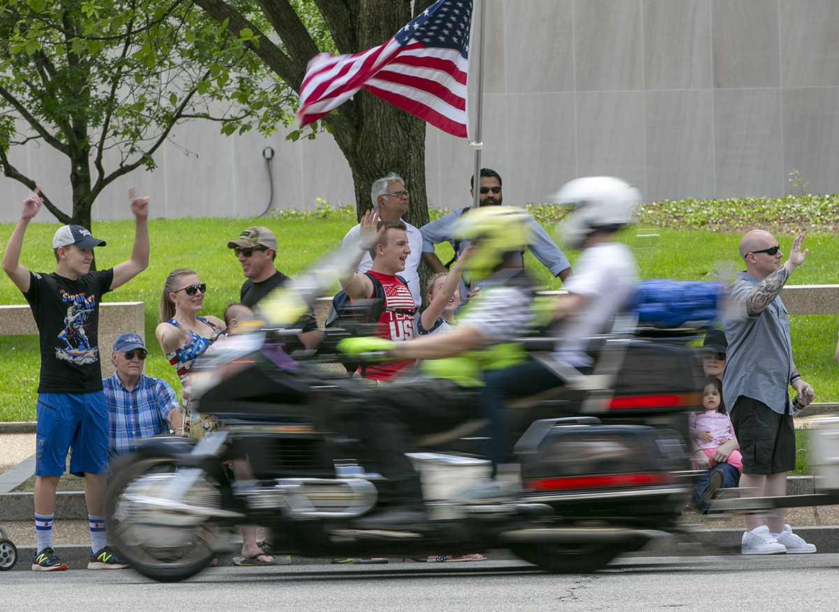 Spectators waved to riders during the Rolling Thunder XXXI First Amendment Demonstration Run along Constitution Ave. in Washington, DC on Sunday May 27, 2018. Motorcycle riders from across the nation, rode a designated route through the Mall area of Washington, D.C. The event is an actual demonstration/protest to bring awareness and accountability for POWs and MIAs left behind.(Alan Lessig/Staff)