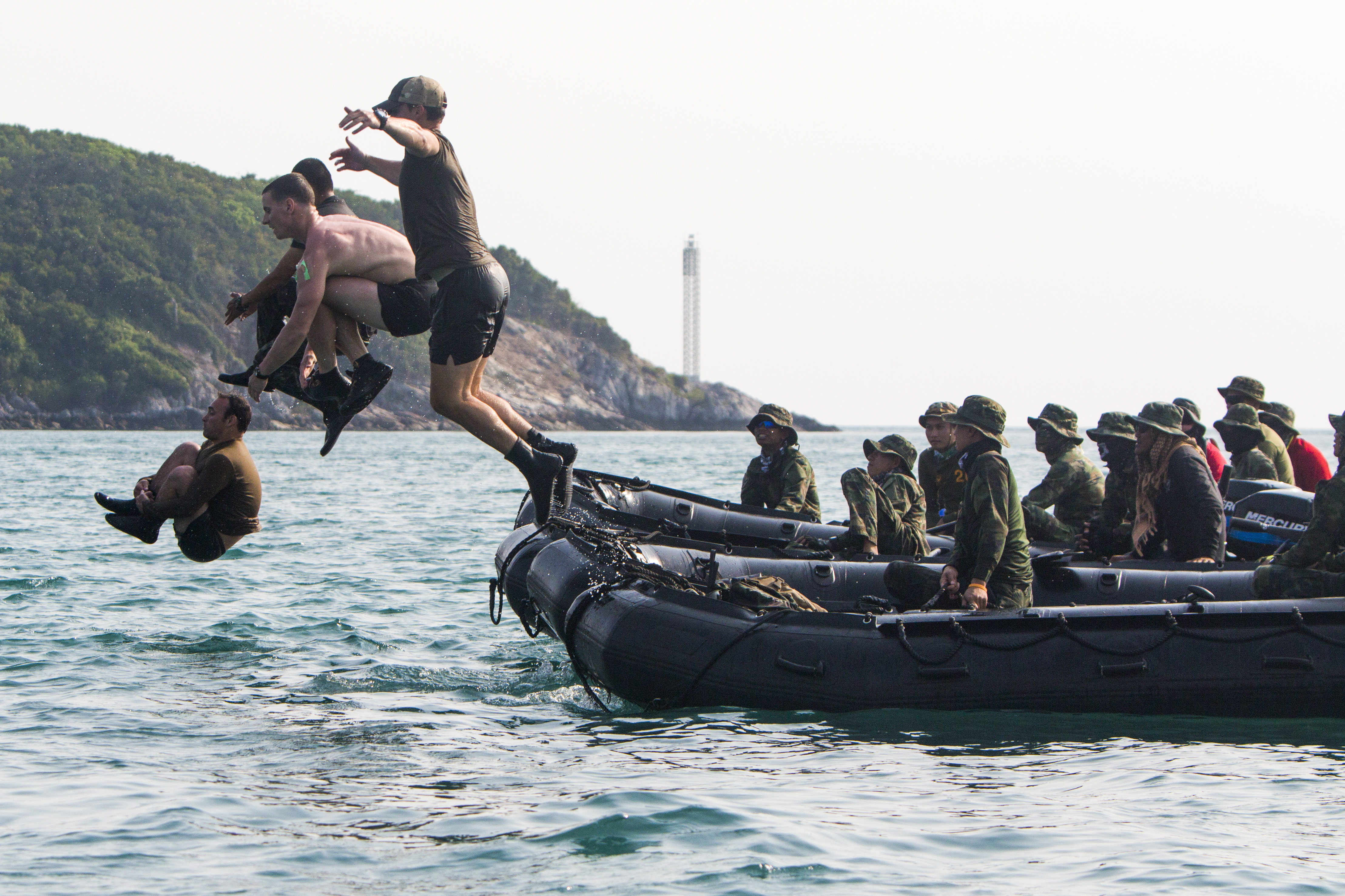 U.S., Thai and Republic of Korea Marines conduct jumping competitions between helocast training runs during Exercise Cobra Gold 2018 in Sattahip, Chonburi province, Kingdom of Thailand, Feb. 12, 2018. Helocasting is a method of inserting reconnaissance and surveillance teams in support of small boat operations. This training provided a venue for both United States and partner nations to advance interoperability and increase partner capacity in planning and executing complex and realistic multinational force and combined task force operations. Cobra Gold 18 is an annual exercise conducted in the Kingdom of Thailand held from Feb. 13-23 with seven full participating nations. (UCpl. Breanna L. Weisenberger/Marines)