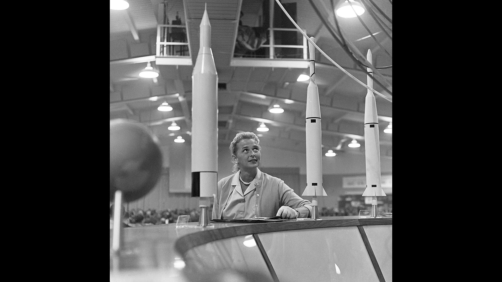 This May 26, 1961, file photo shows Jerrie Cobb, the nation's first female astronaut candidate, with a display of rockets at a national conference where the leading space experts gathered in Tulsa, Okla. Cobb died in Florida at the age of 88 on March 18, 2019. (William P. Straeter/AP)