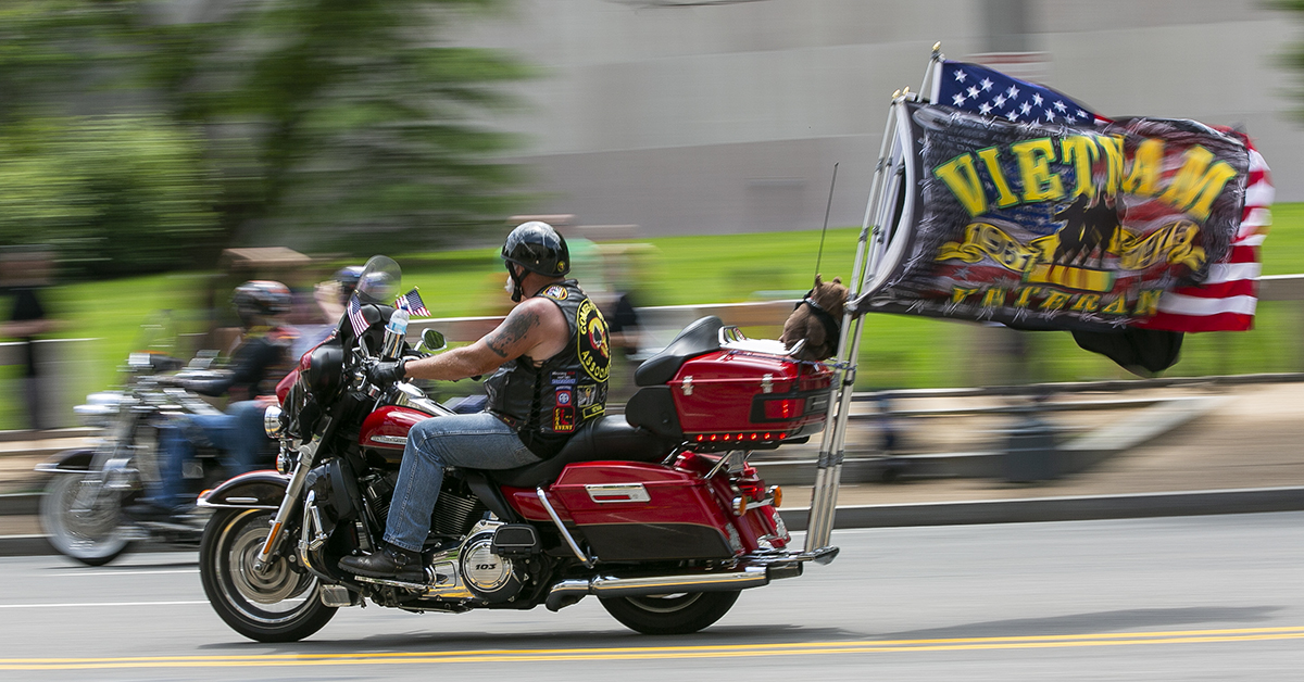 Riders flew flags of many colors in addition to the Stars and Stripes during during Rolling Thunder XXXI First Amendment Demonstration Run in Washington, DC on Sunday May 27, 2018. Motorcycle riders from across the nation, rode a designated route through the Mall area of Washington, D.C. The event is an actual demonstration/protest to bring awareness and accountability for POWs and MIAs left behind.(Alan Lessig/Staff)